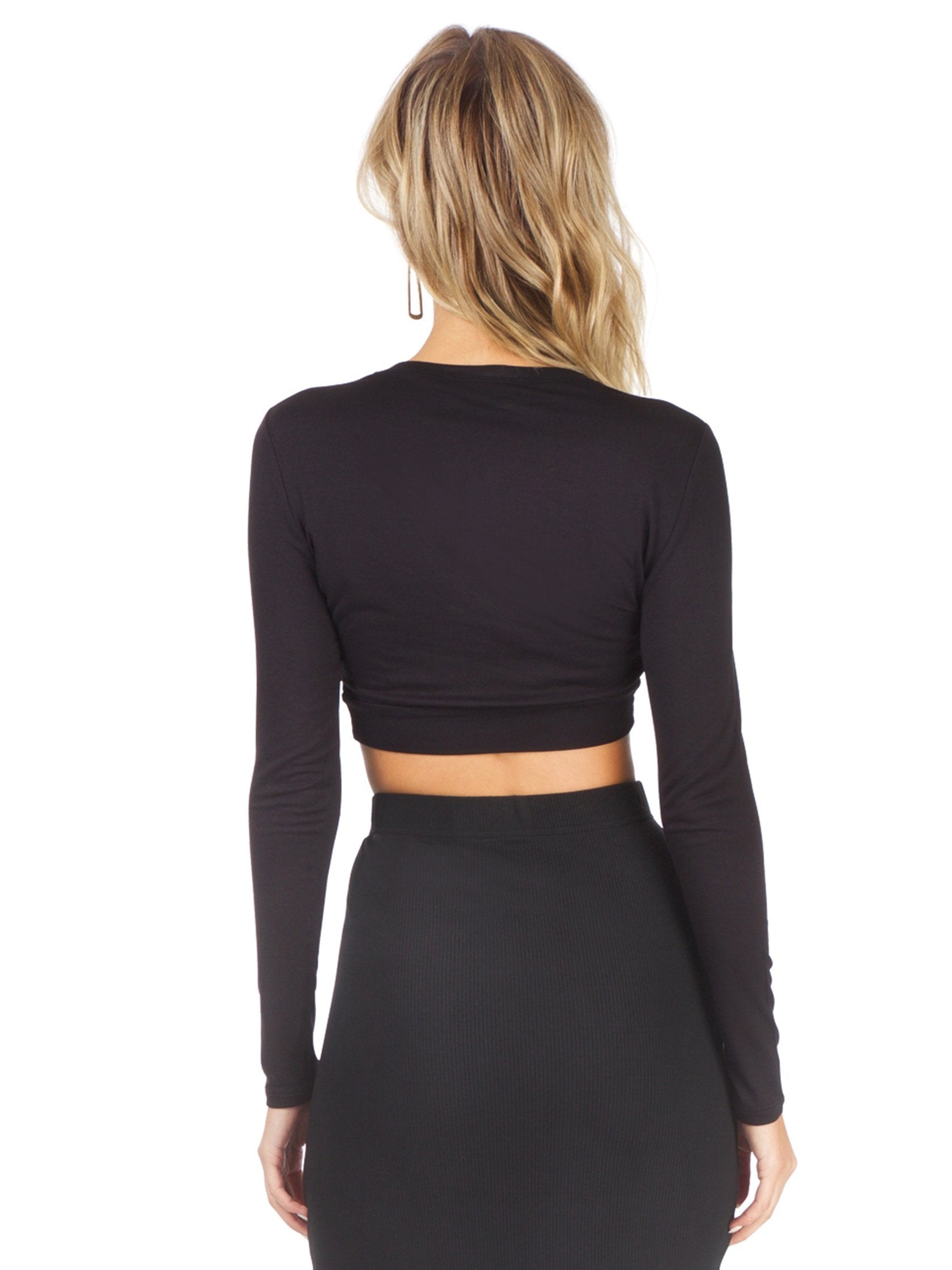 Women wearing a top rental from BCBGMAXAZRIA called Twisted Crop Top