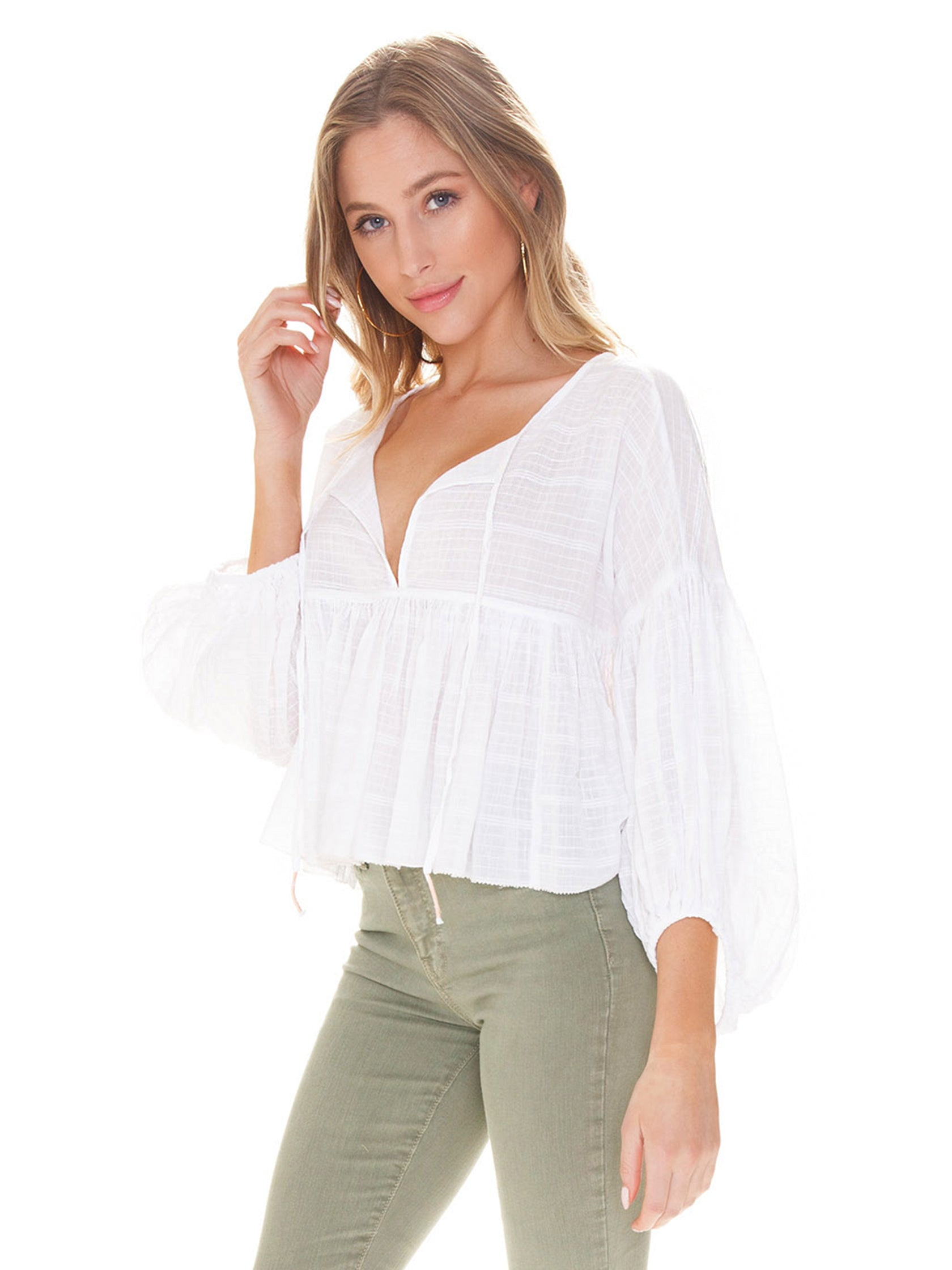 Women wearing a top rental from Free People called Beaumont Mews Stripe Blouse