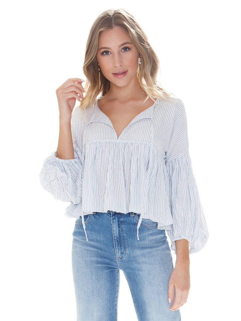 Woman wearing a top rental from Free People called Pip Spot Tie Front Bodice