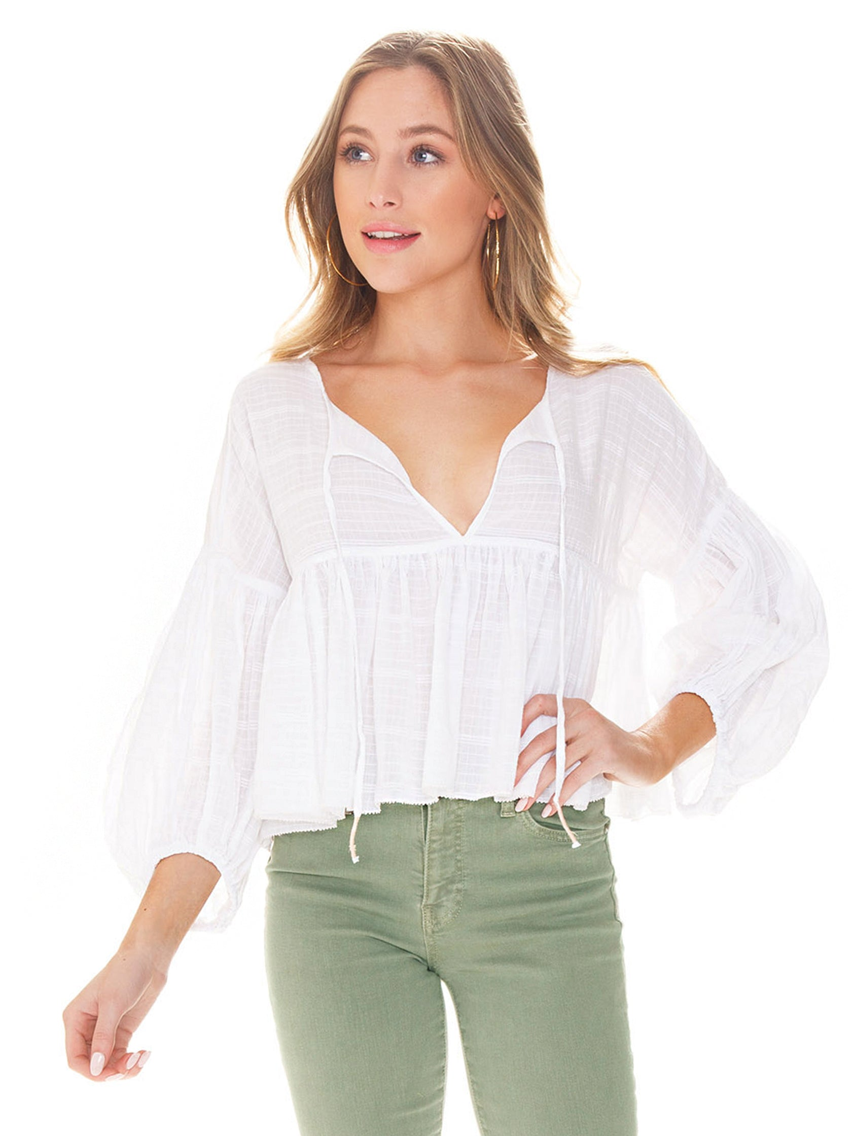 Woman wearing a top rental from Free People called Beaumont Mews Stripe Blouse