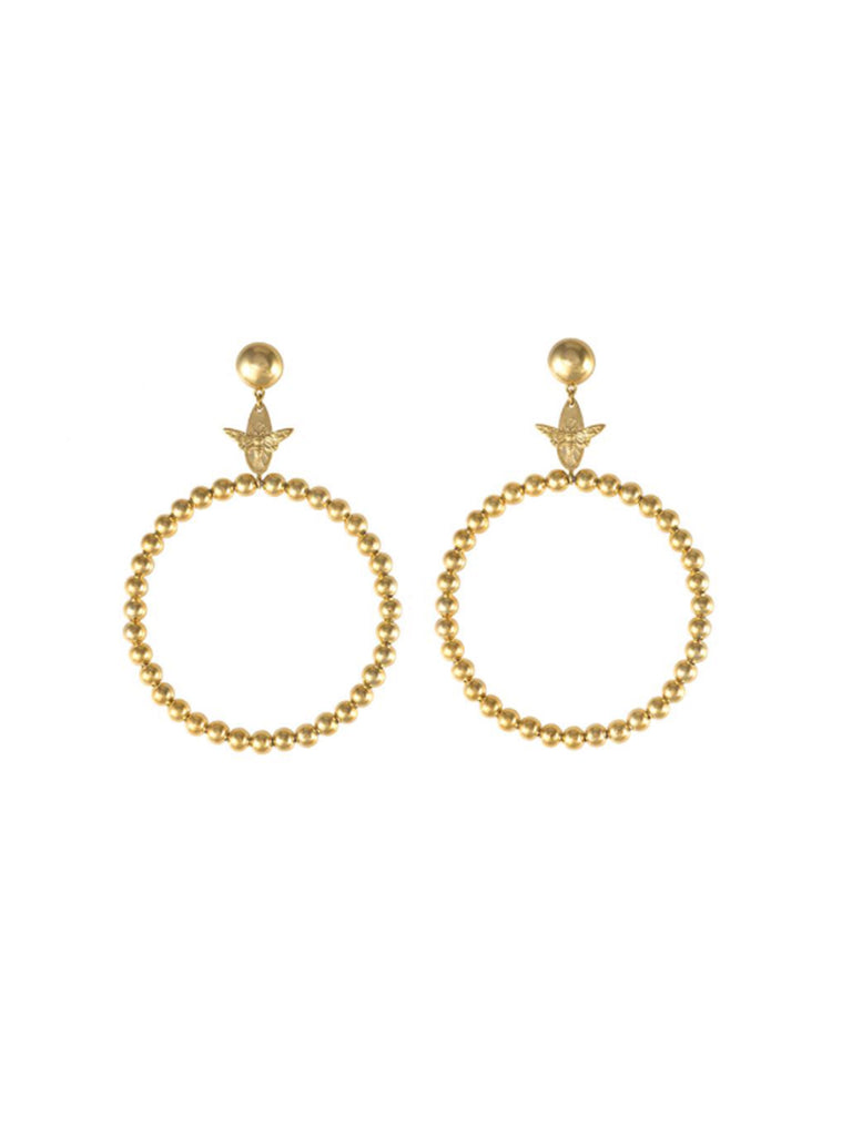 Women outfit in a earrings rental from Wanderlust + Co called Zodiac Gold Ring (select Your Sign)