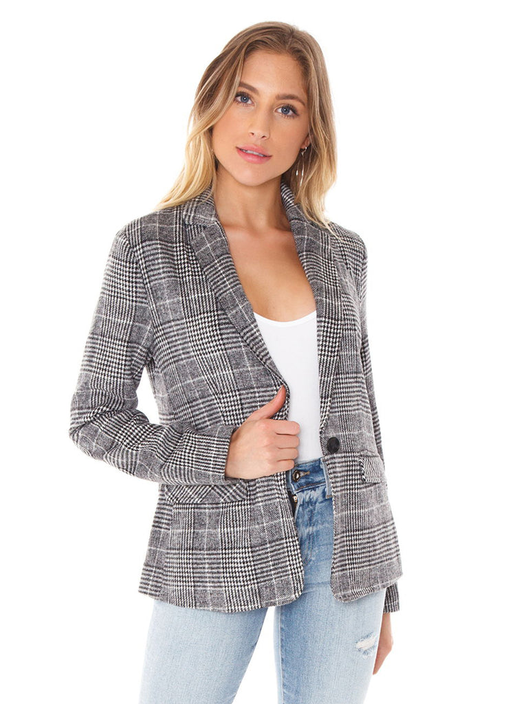 Woman wearing a blazer rental from Cupcakes and Cashmere called Blair Velvet Bodysuit