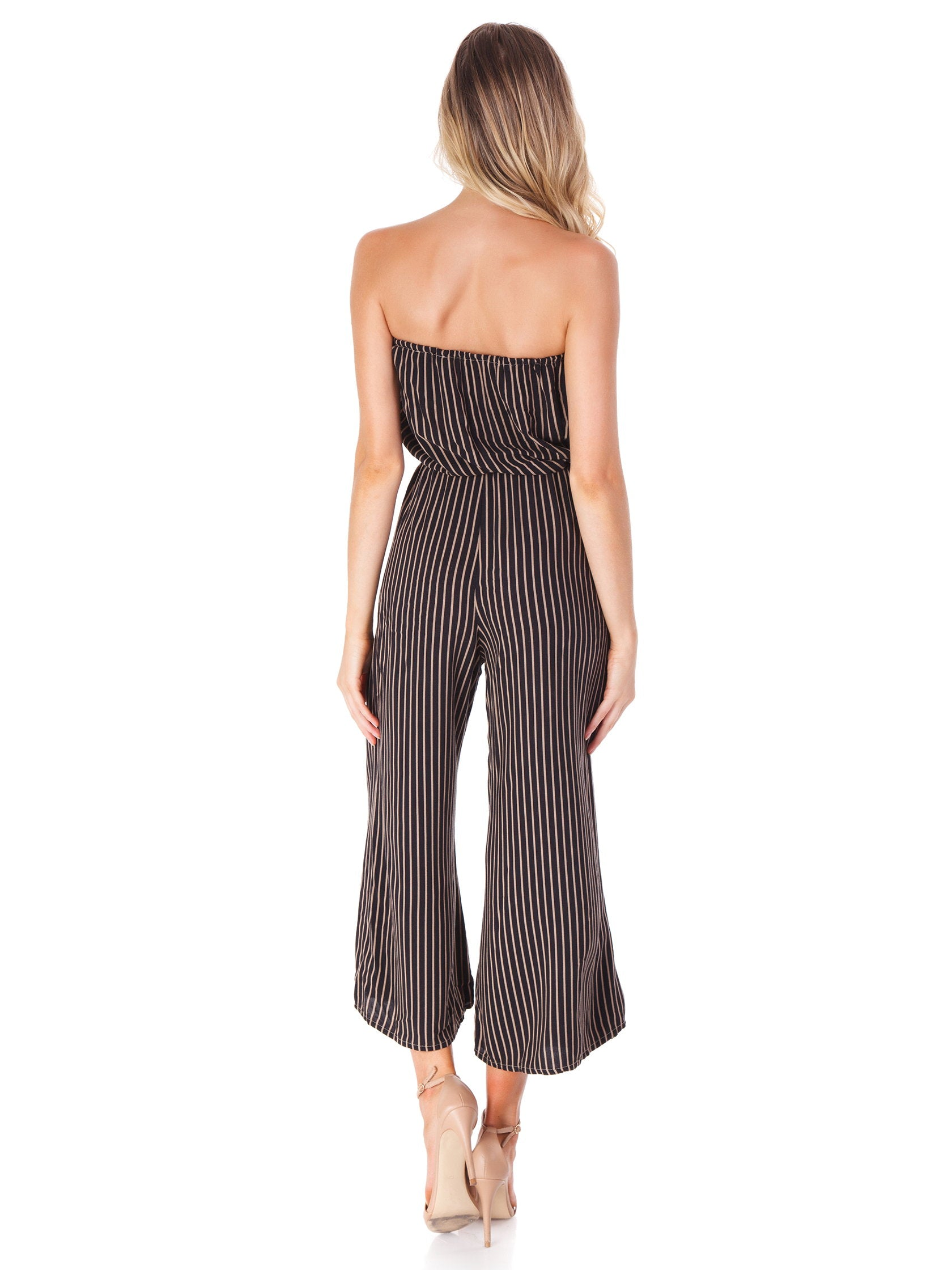 Women wearing a jumpsuit rental from Blue Life called Stripe Bell Jumper