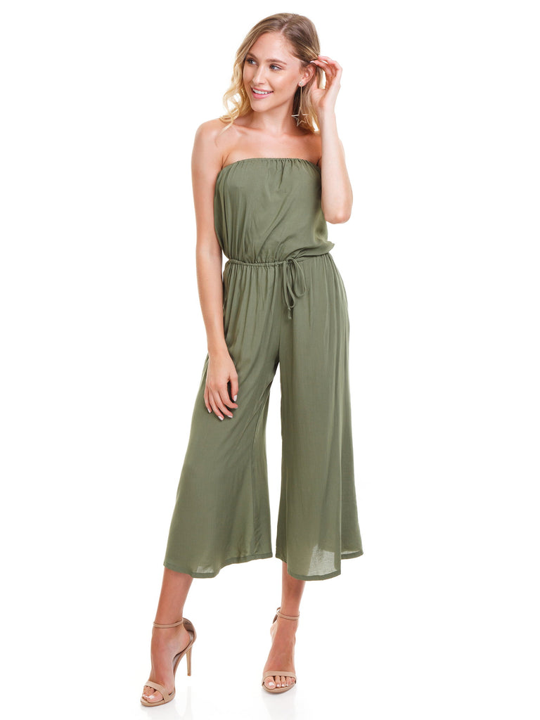 Woman wearing a jumpsuit rental from Blue Life called Scrunched Up Off Shoulder Bikini Top