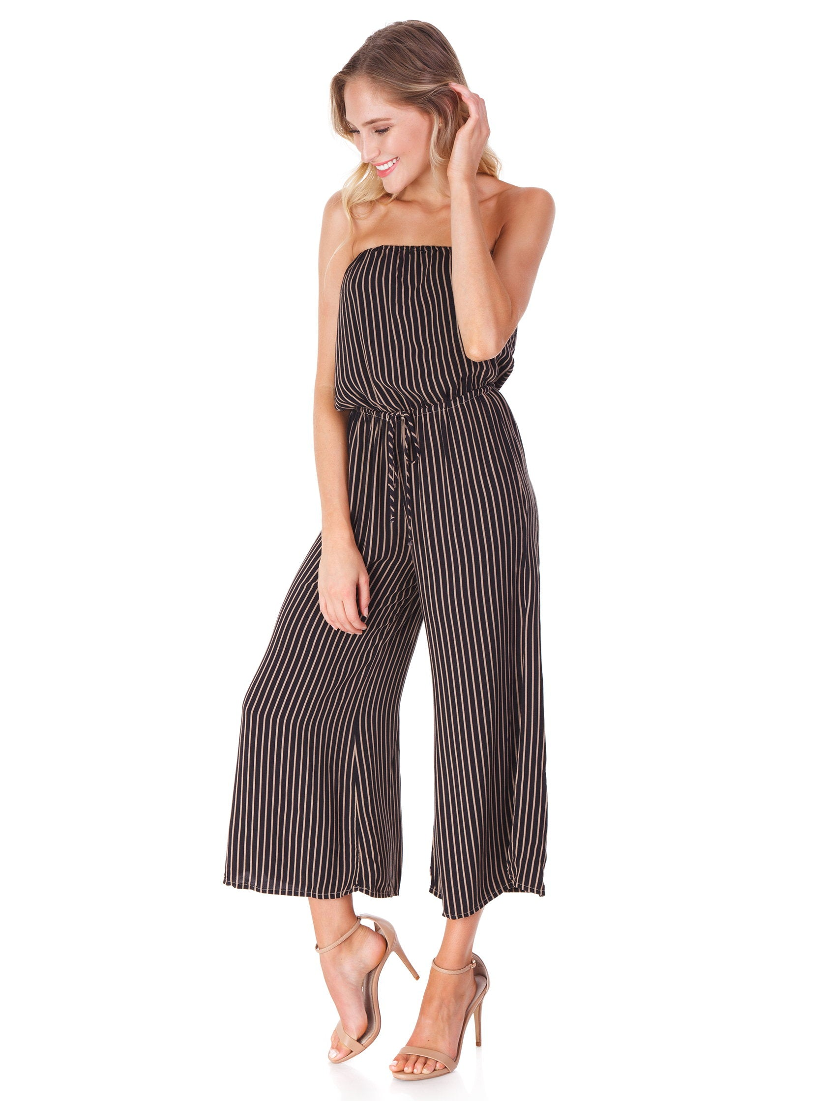Woman wearing a jumpsuit rental from Blue Life called Stripe Bell Jumper