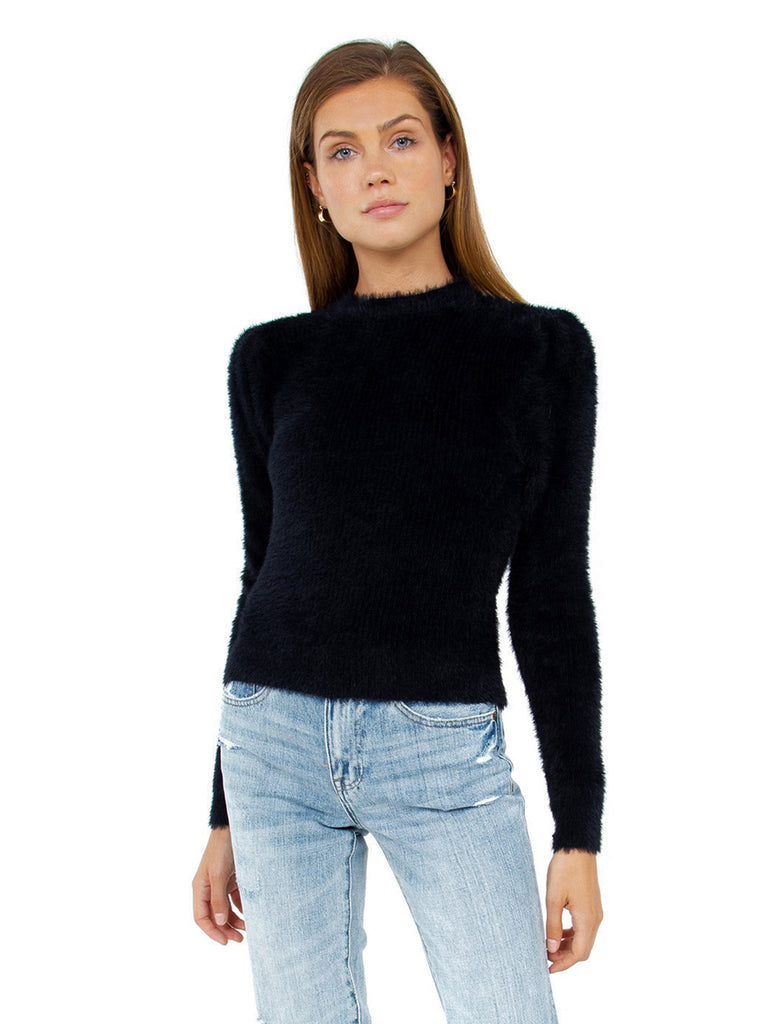 Women wearing a sweater rental from ASTR called Bi-coastal Cardigan