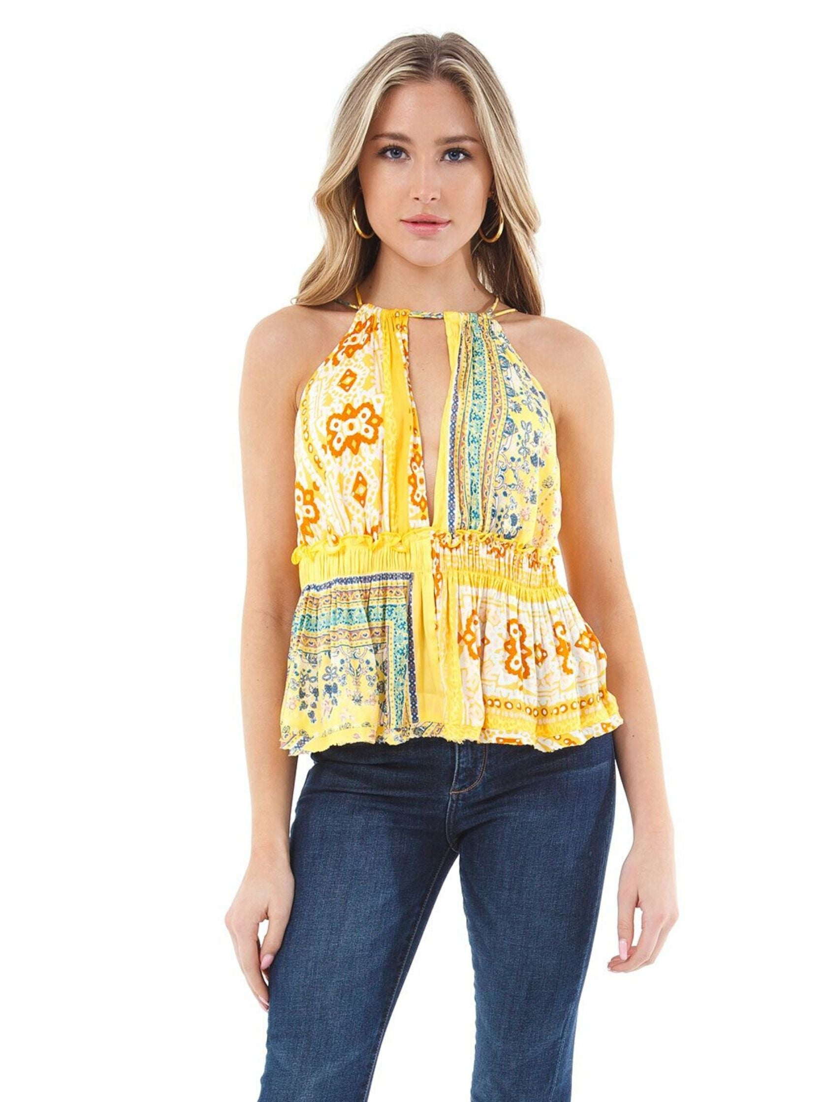 Woman wearing a cami rental from Free People called Bellini Patchwork Tank