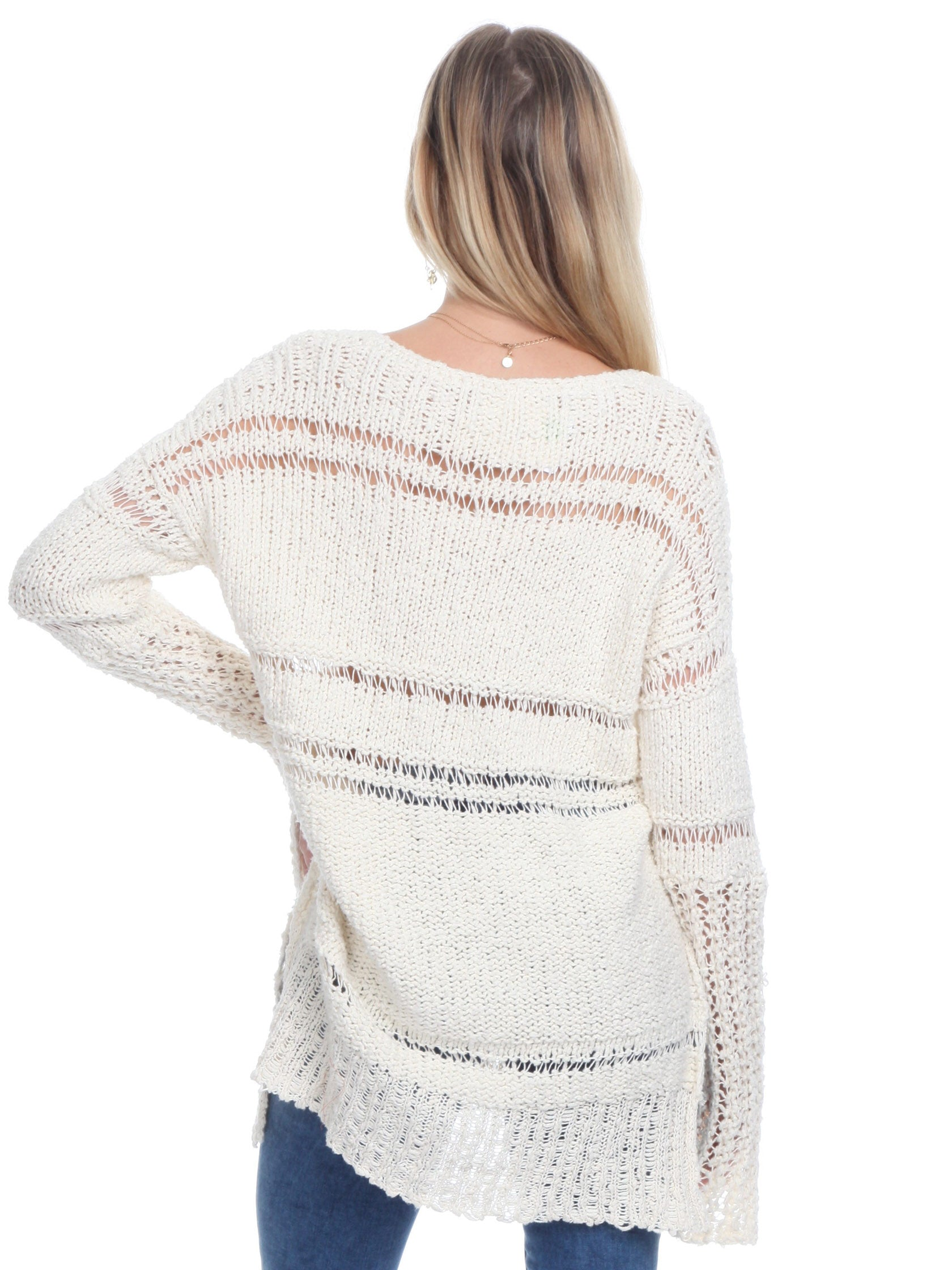 Women outfit in a sweater rental from Free People called Belong To You Sweater