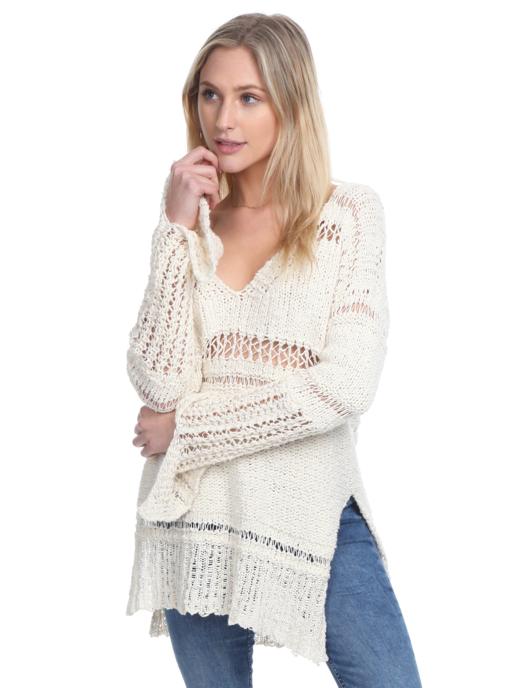 Woman wearing a sweater rental from Free People called Belong To You Sweater