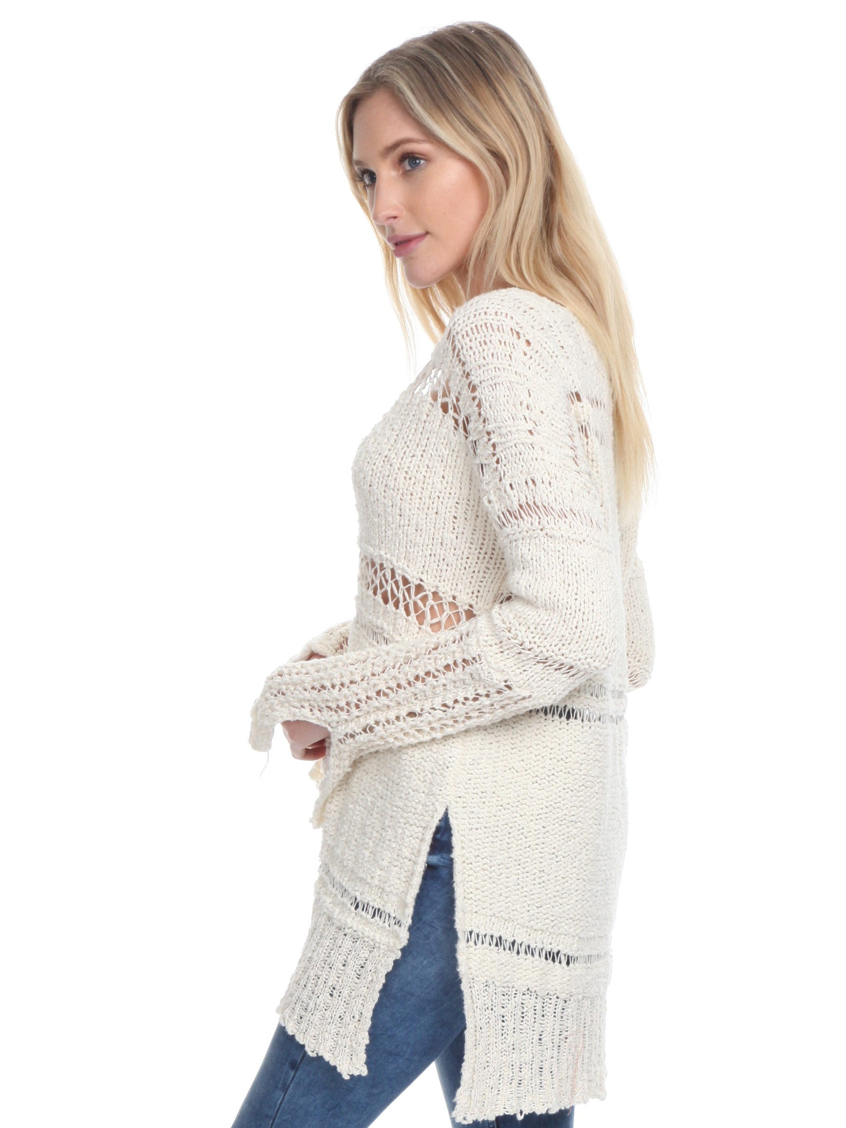 Women wearing a sweater rental from Free People called Belong To You Sweater