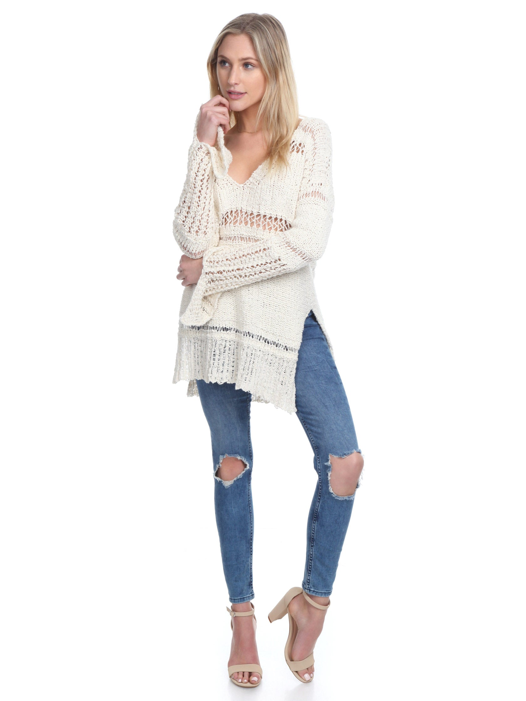 Girl wearing a sweater rental from Free People called Belong To You Sweater