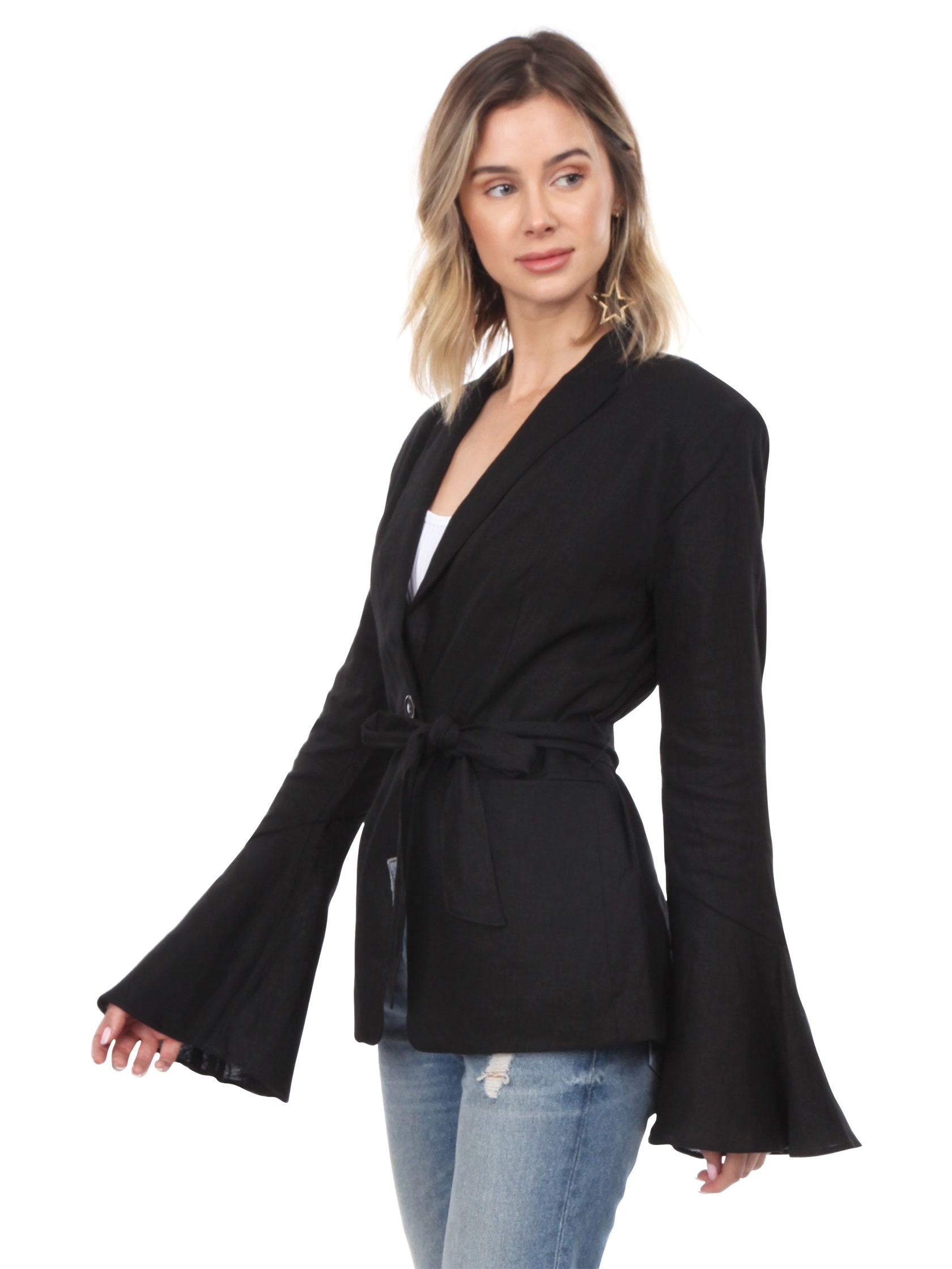 Woman wearing a blazer rental from Free People called Belted Blazer