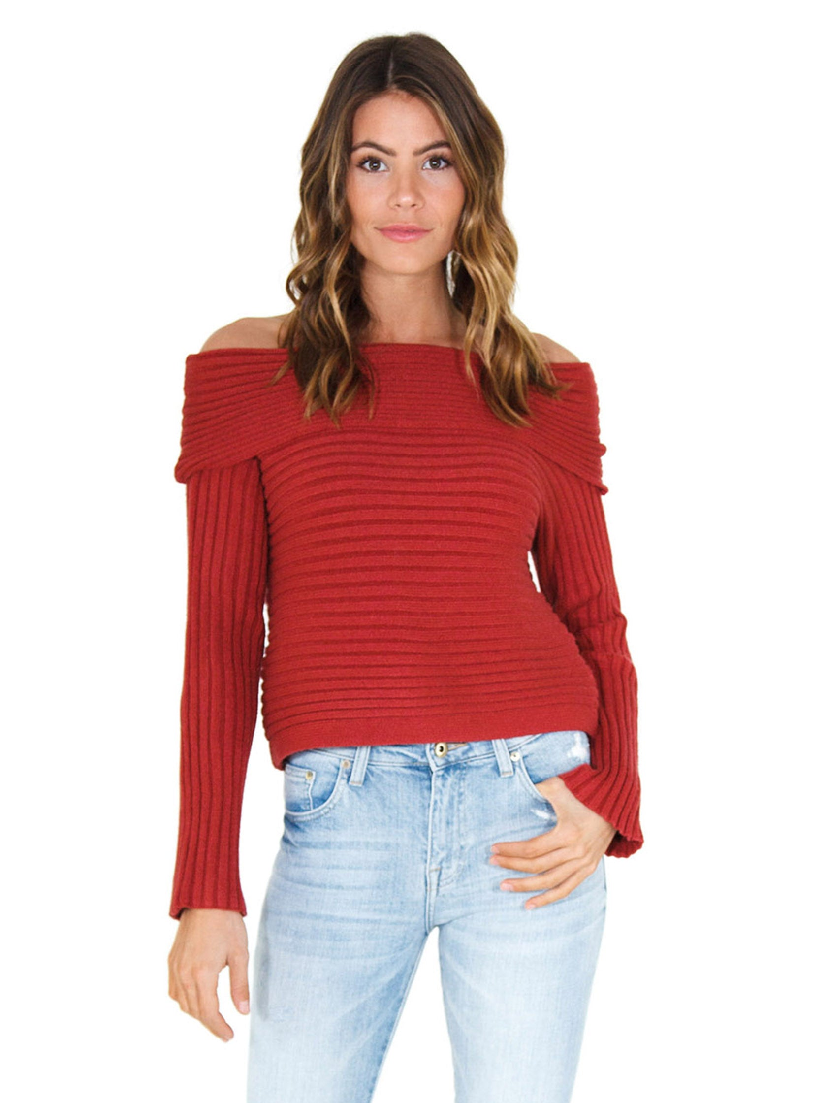 Woman wearing a sweater rental from Line & Dot called Benigna Off Shoulder Sweater