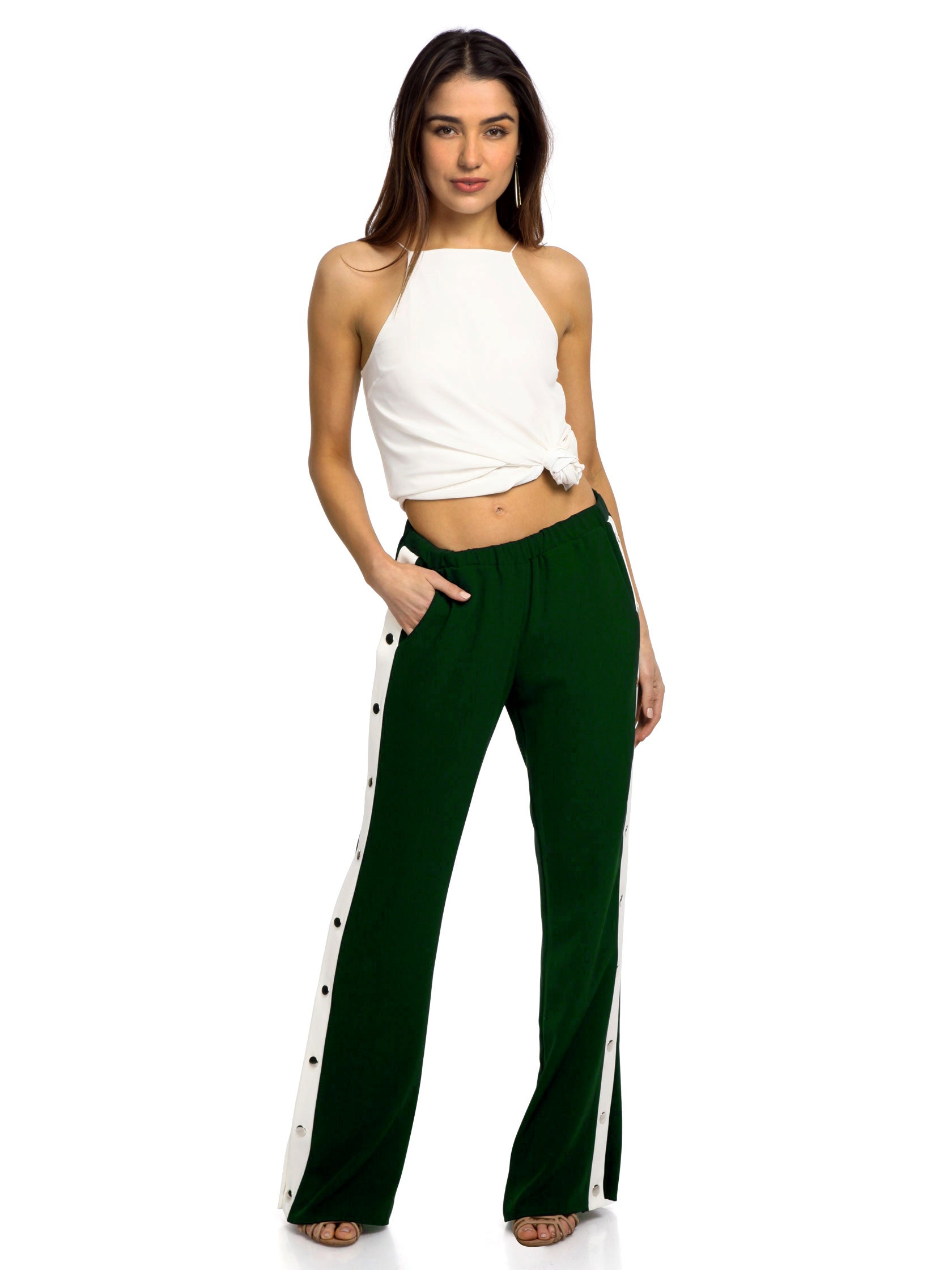 Woman wearing a pants rental from Amanda Uprichard called Bergen Track Pant