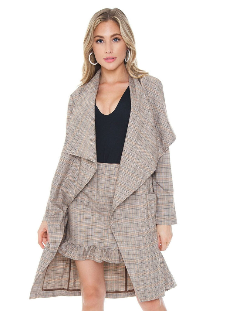 Women wearing a jacket rental from Cupcakes and Cashmere called Shady Sarong Skirt