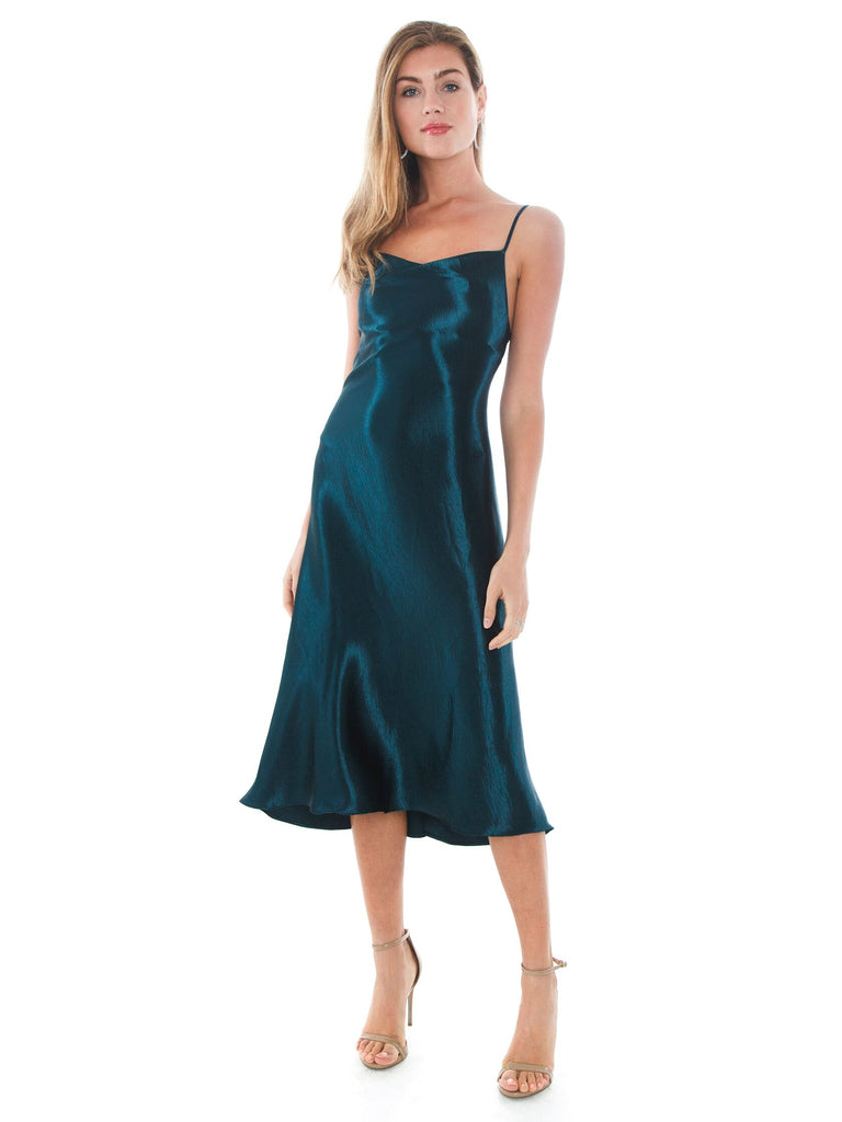 Woman wearing a dress rental from RESA called Dancer Wrap Dress