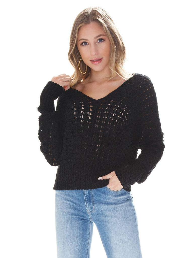 Woman wearing a sweater rental from Free People called Saturdays Longline Cardi
