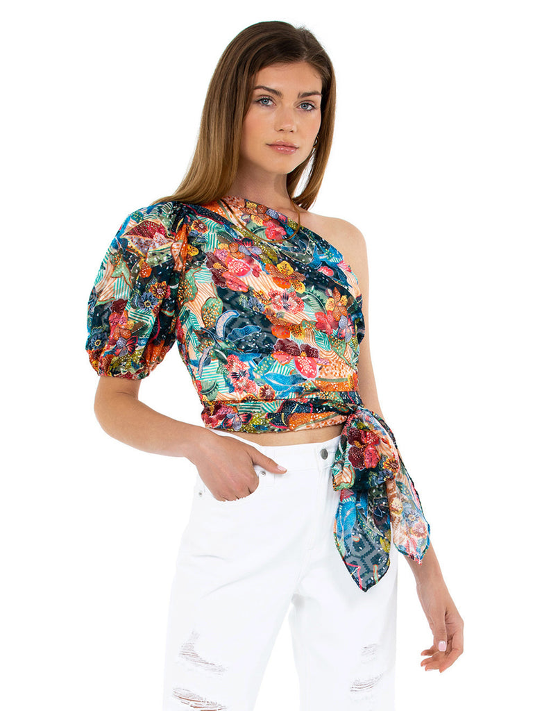 Women outfit in a top rental from Amanda Uprichard called Grateful Dead Tie Dye Long Sleeve Crop