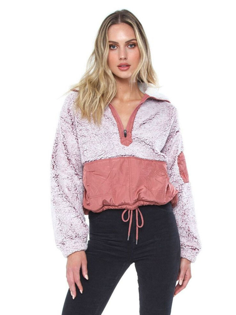 Woman wearing a jacket rental from Free People called Snowbunny Long Sleeve Top