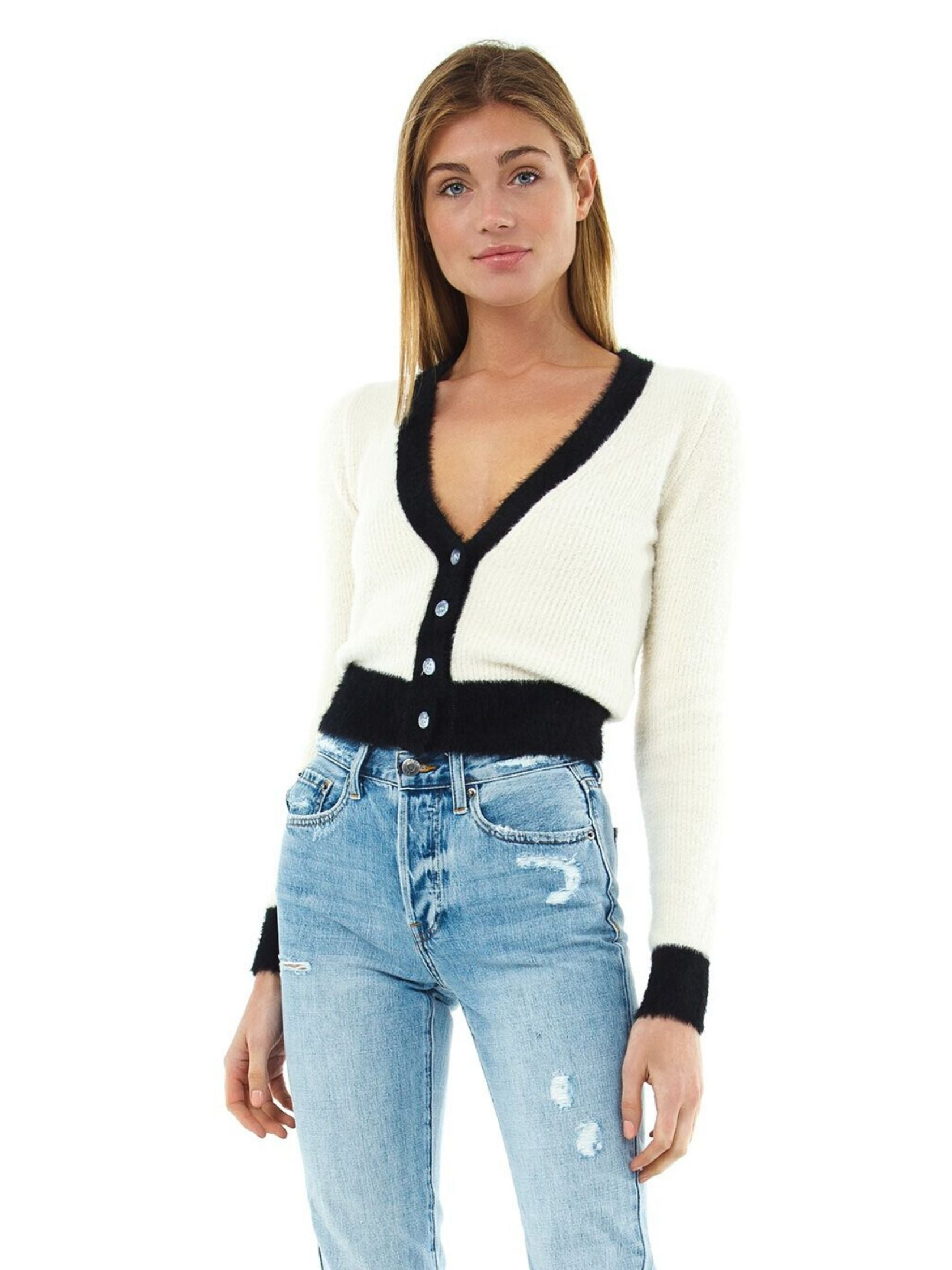 Woman wearing a cardigan rental from ASTR called Bi-coastal Cardigan