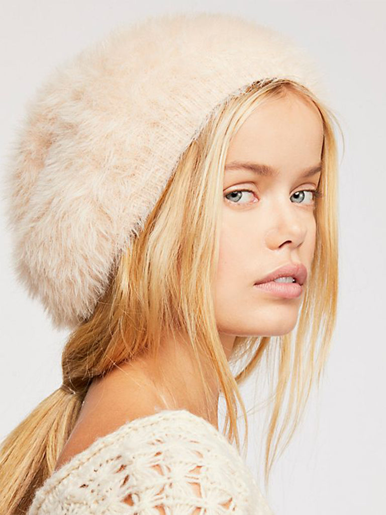 Girl wearing a hat rental from Free People called Beret