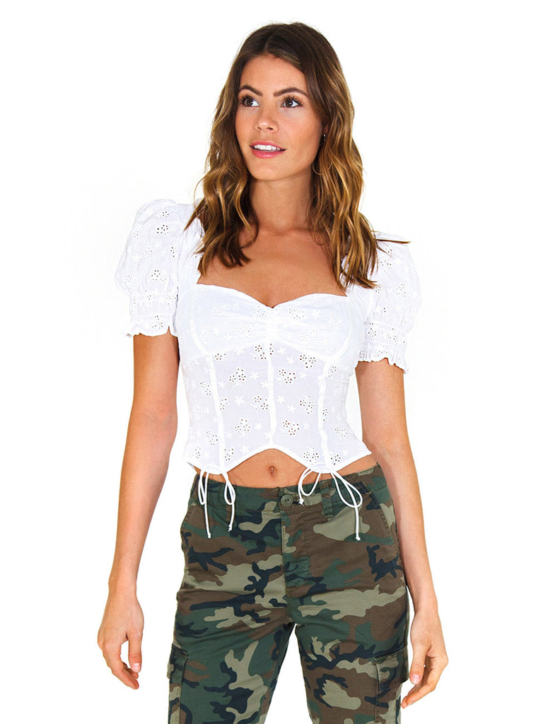 Women wearing a top rental from For Love & Lemons called Bleau Short Sleeve Top