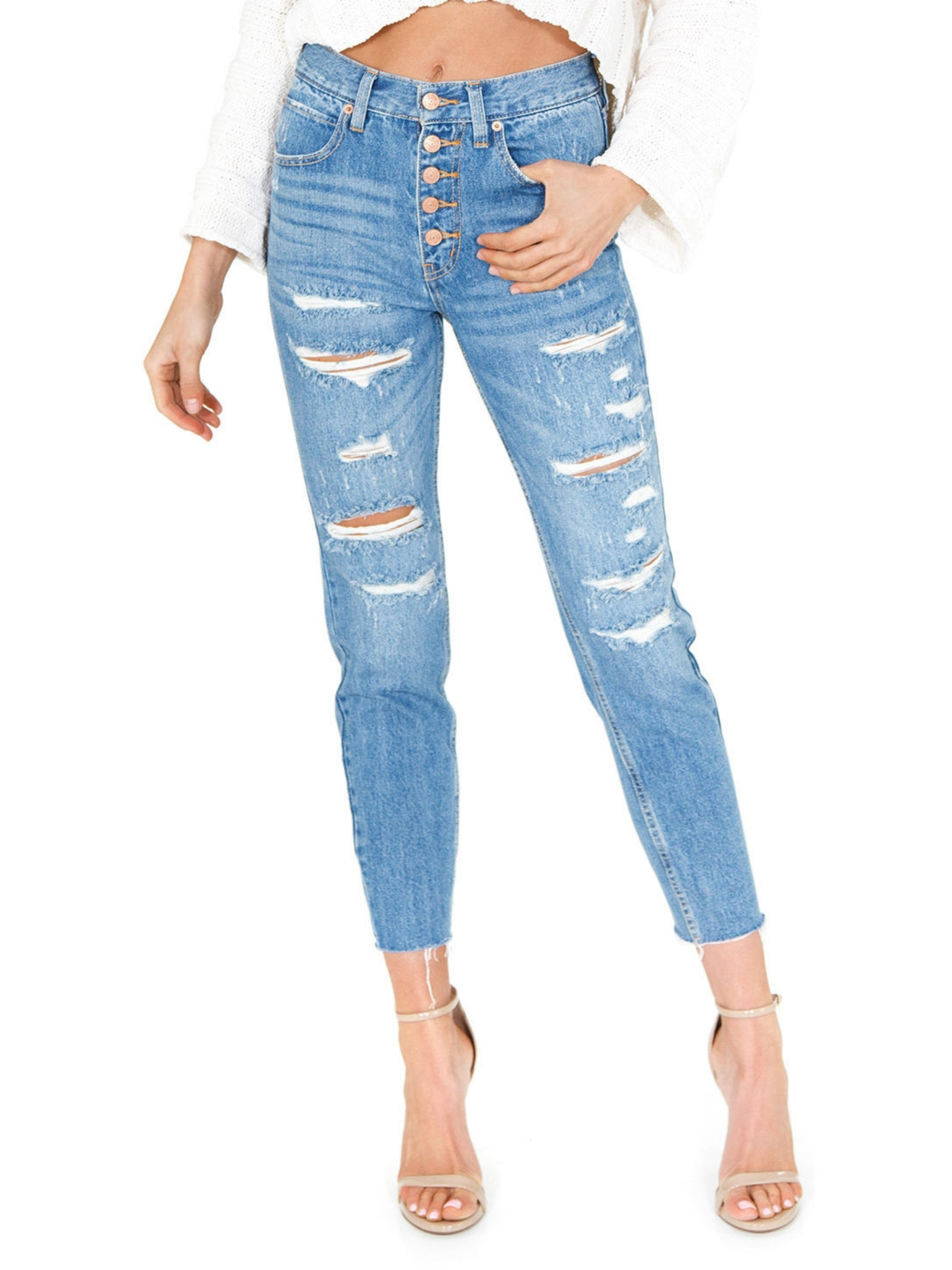 Woman wearing a bottoms rental from Free People called Blossom Rigid Skinny Jeans