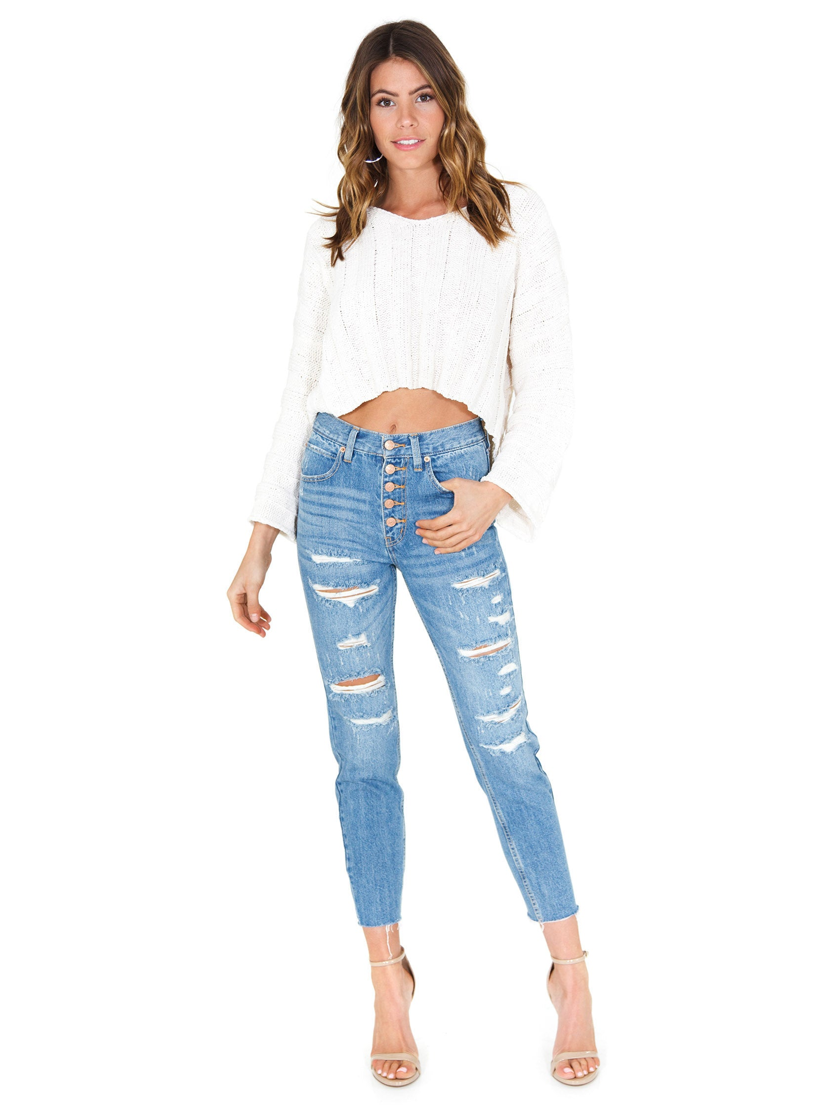 Girl wearing a bottoms rental from Free People called Blossom Rigid Skinny Jeans