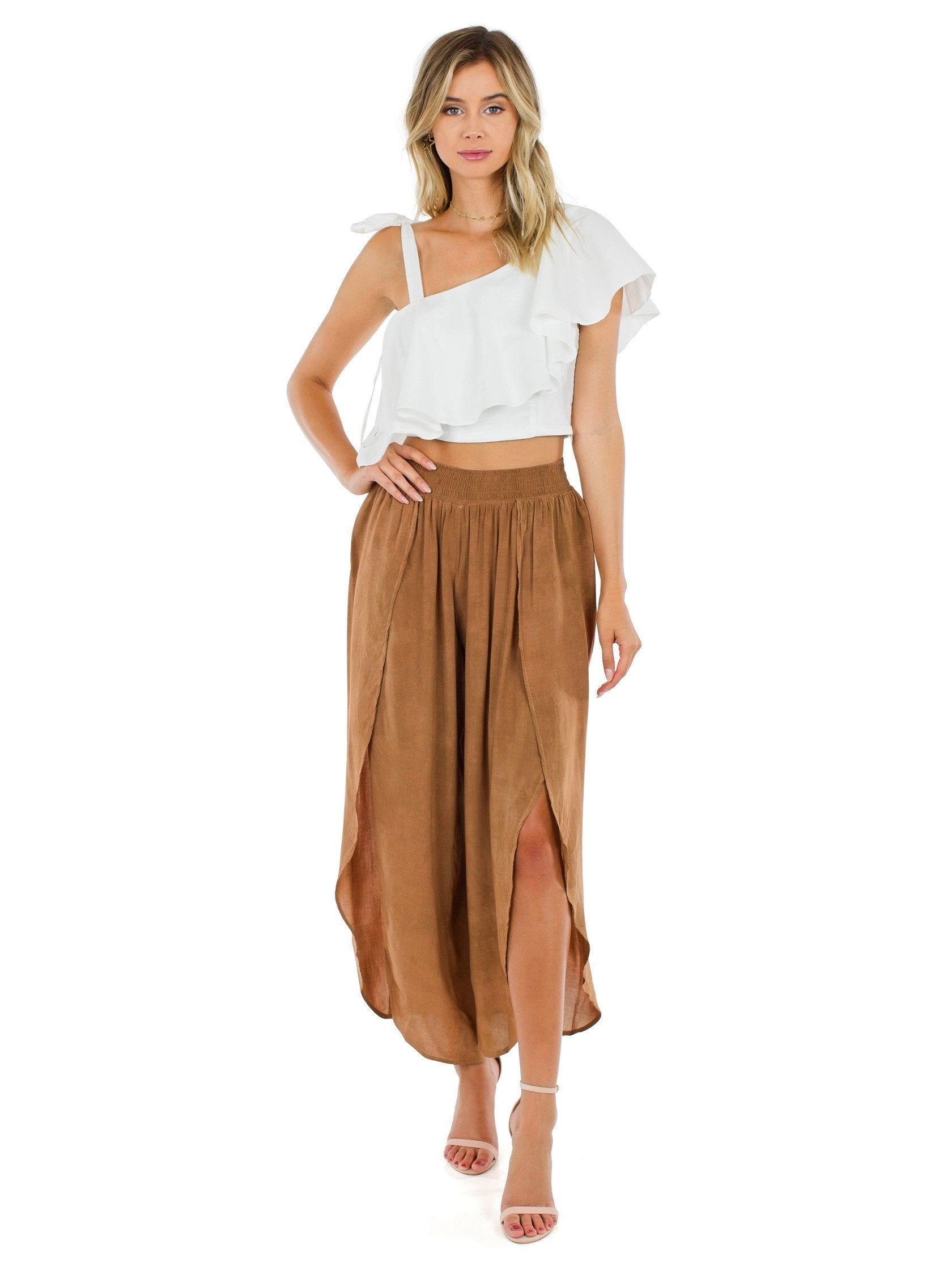 Woman wearing a pants rental from Blue Life called Jeanne Wrap Culotte