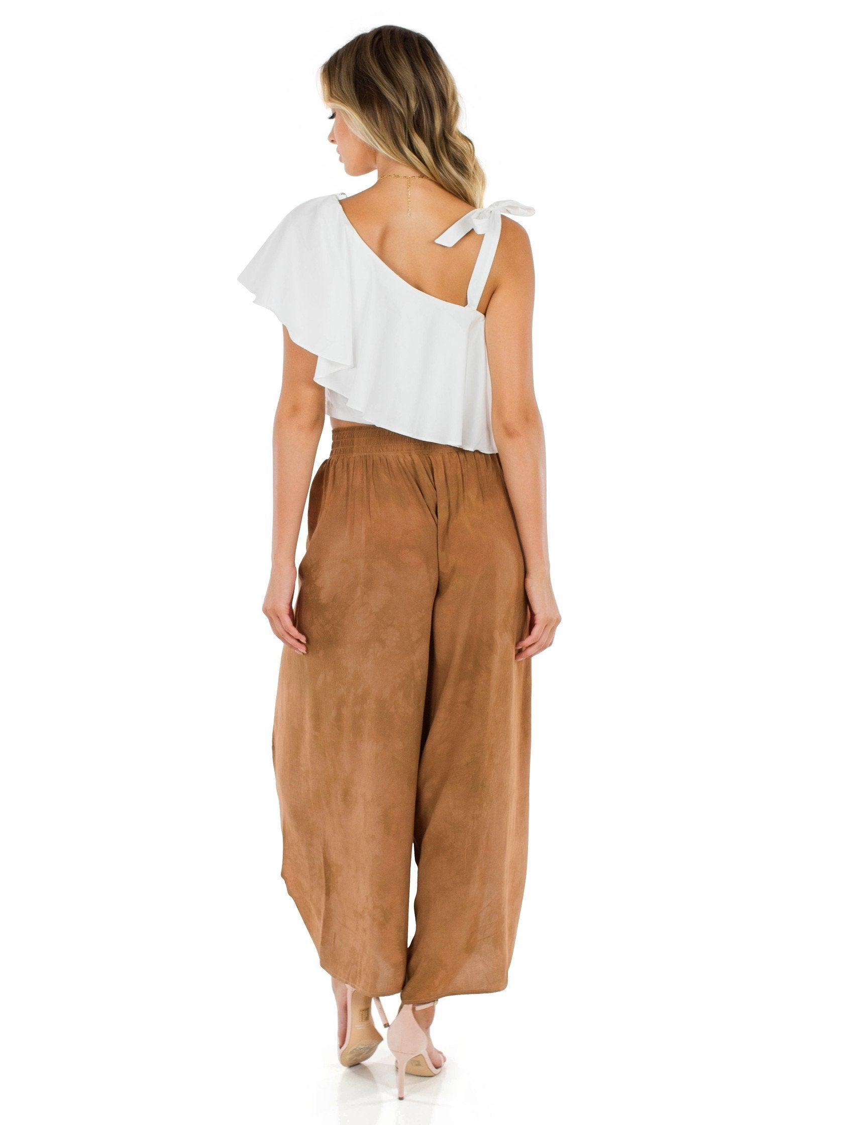 Women wearing a pants rental from Blue Life called Jeanne Wrap Culotte