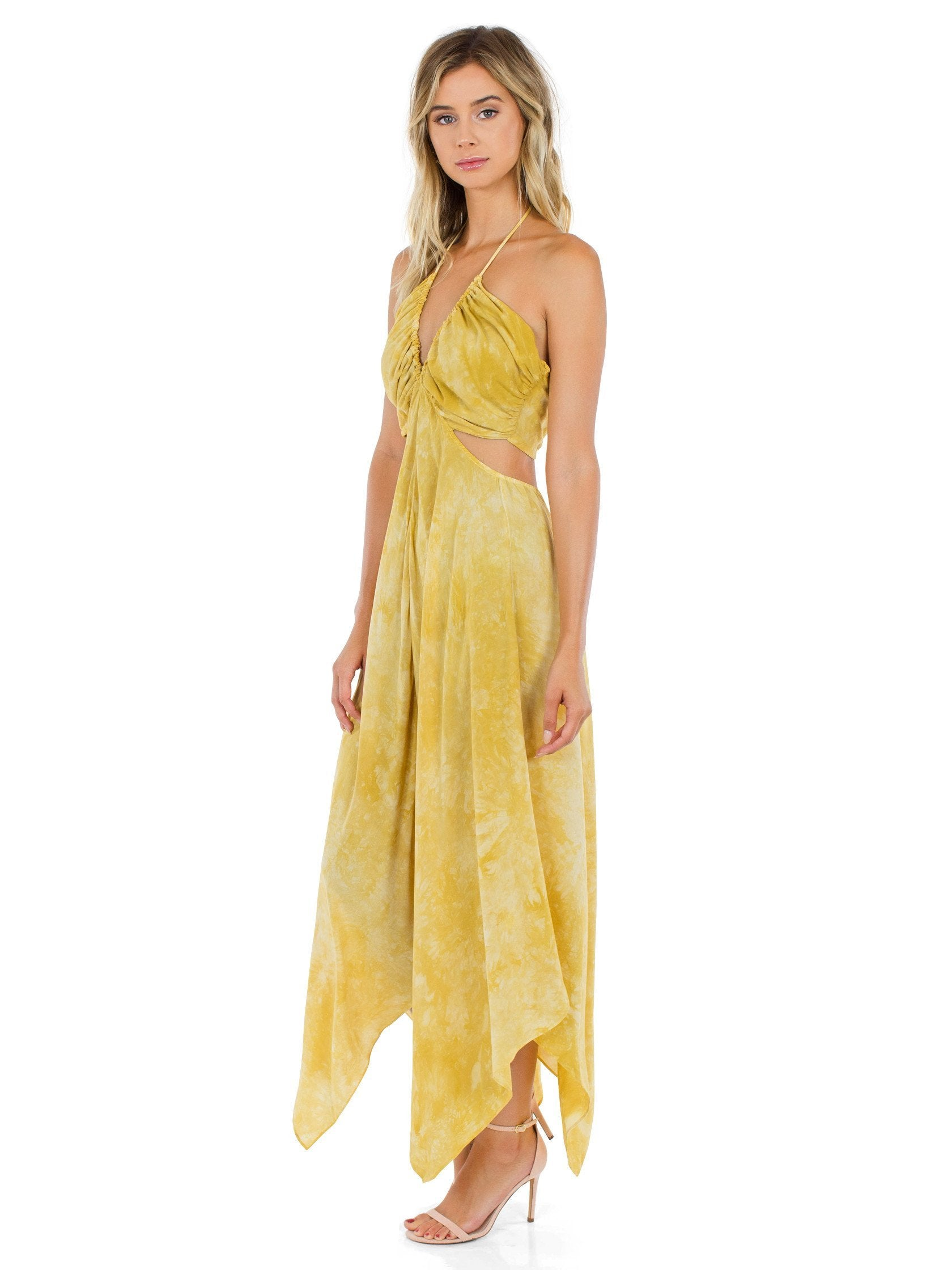 Woman wearing a dress rental from Blue Life called Summer Breeze Halter Maxi
