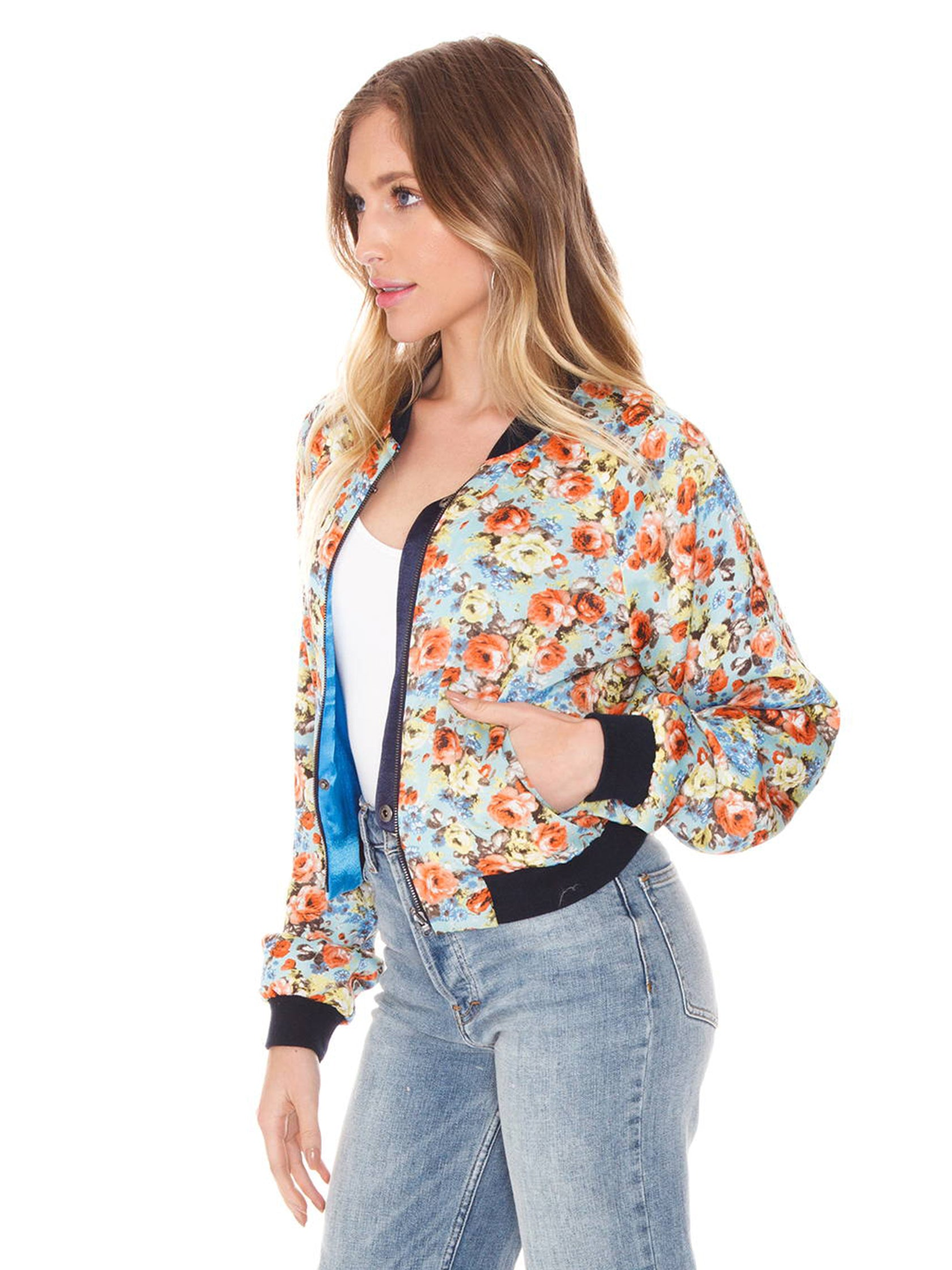 Woman wearing a jacket rental from FLETCH called Blue Reversible Bomber