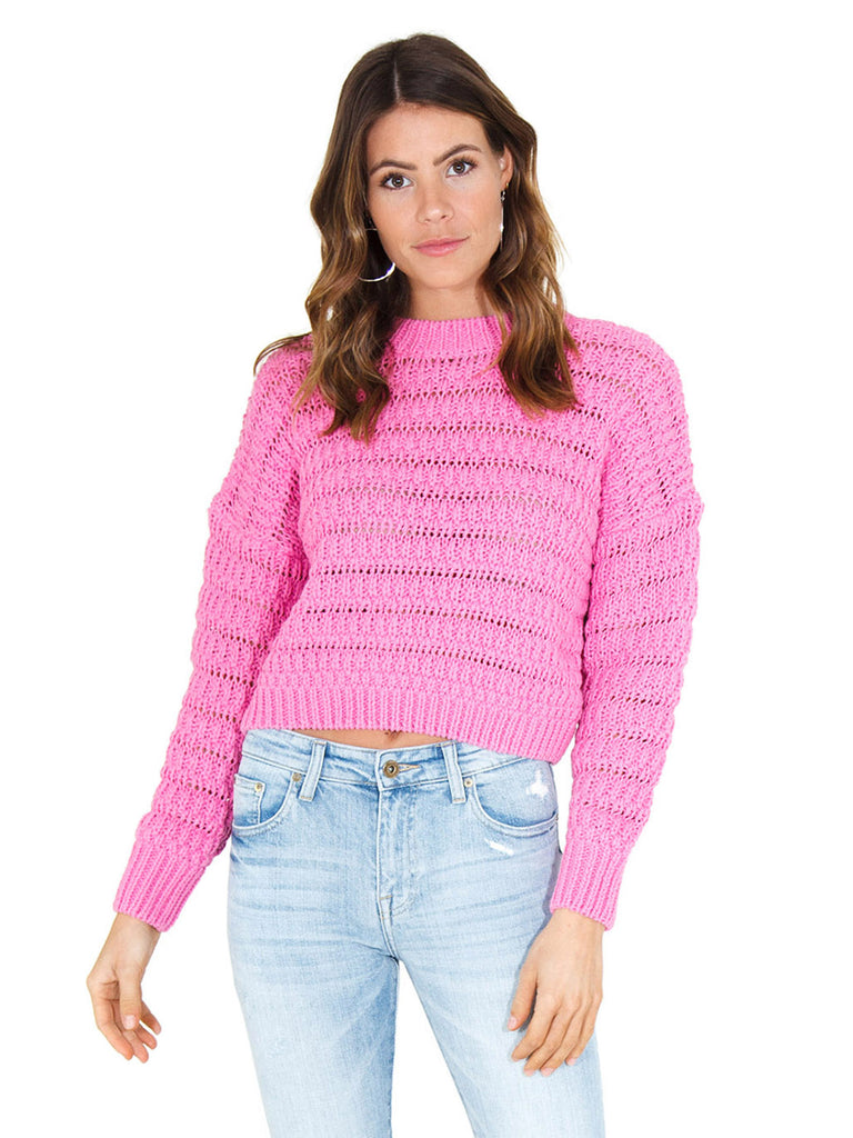 Girl wearing a sweater rental from ASTR called Fireside Cropped Sweater