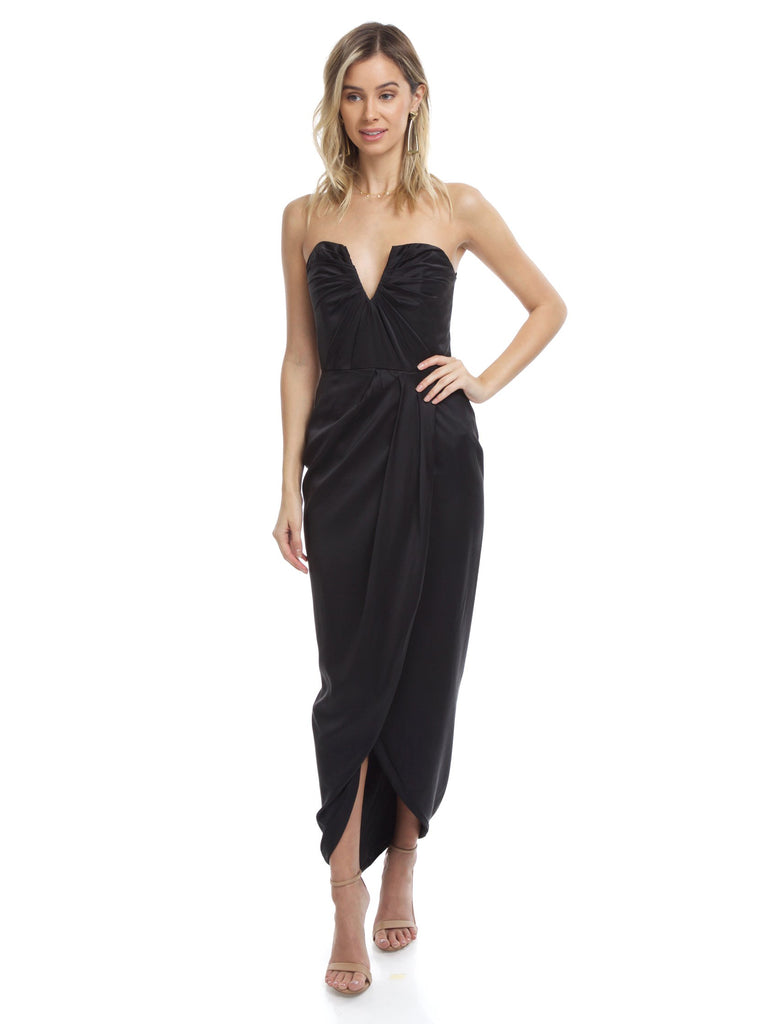 Woman wearing a dress rental from YUMI KIM called Rachel Strapless Gored Maxi Dress