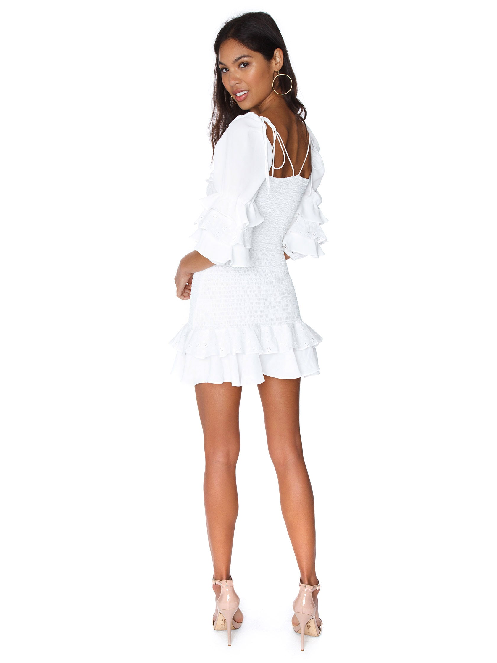 Women wearing a dress rental from For Love & Lemons called Bora Bora Ruffle Mini Dress