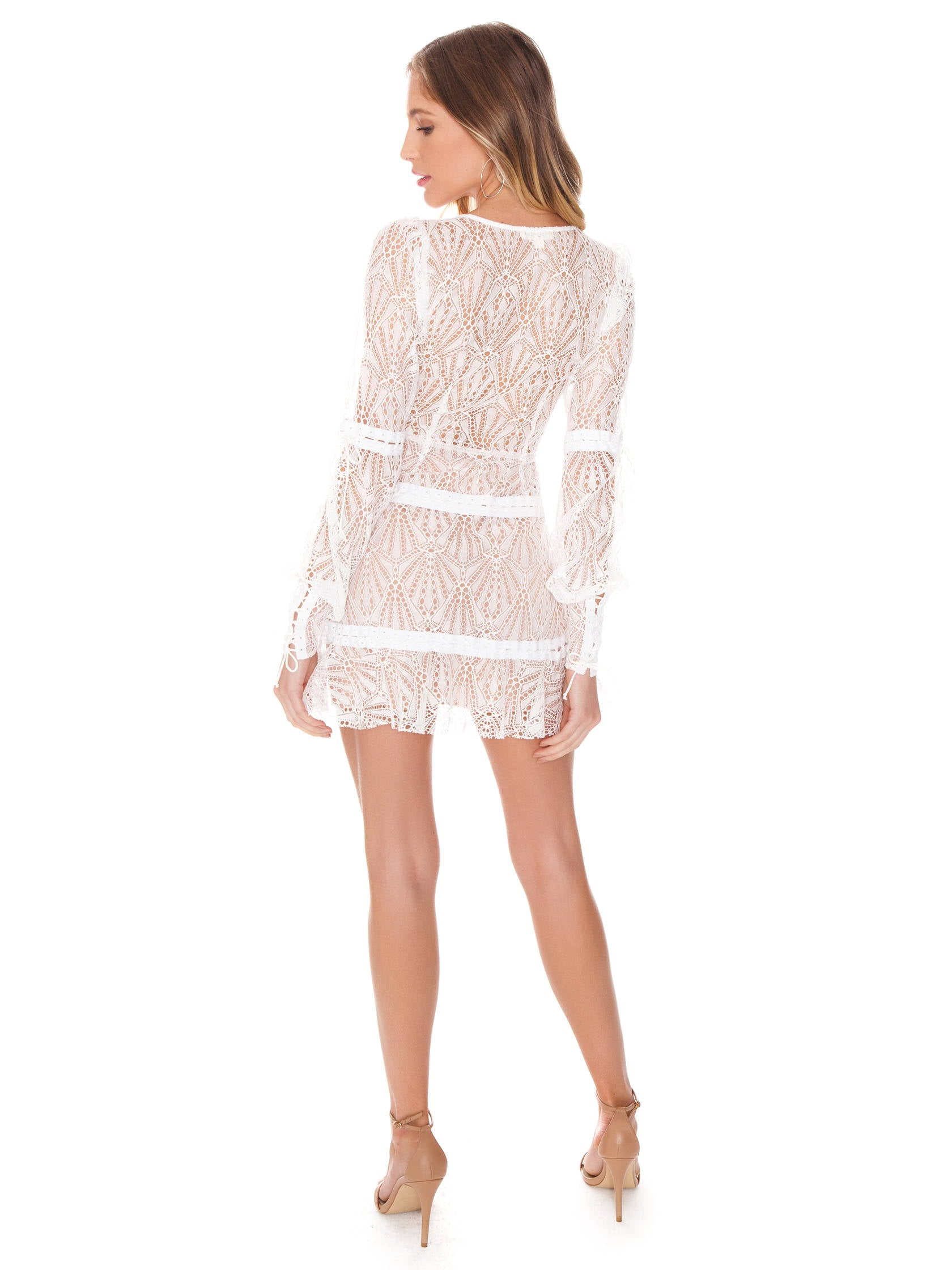 Women wearing a dress rental from For Love & Lemons called Bright Lights Mini Dress
