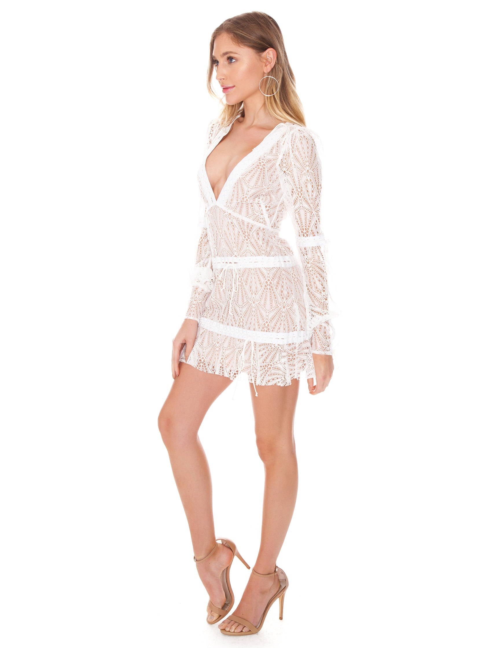 Woman wearing a dress rental from For Love & Lemons called Bright Lights Mini Dress