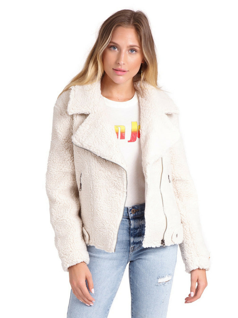 Girl wearing a jacket rental from ASTR called Georgia Sweater