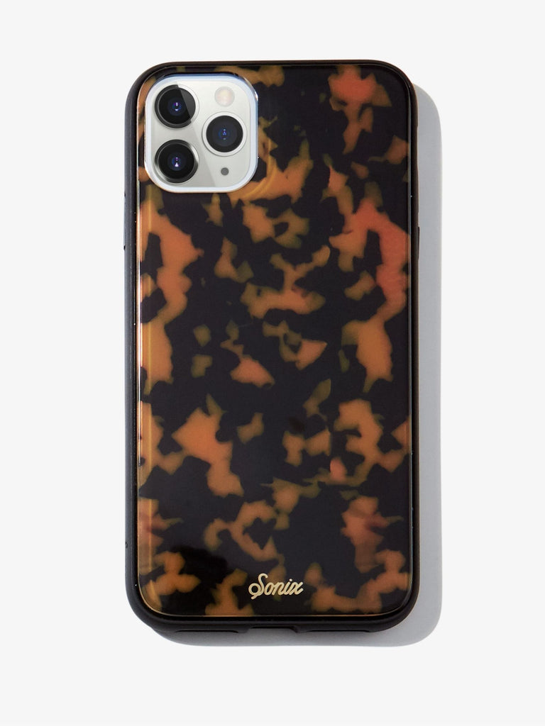 Women wearing a phone case rental from Sonix called Brown Tortoise, 11 Pro Max/ (xs Max)