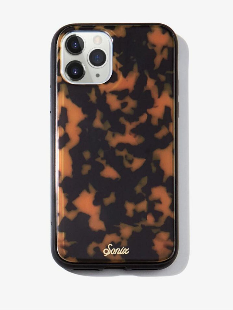 Women wearing a phone case rental from Sonix called Brown Tortoise, 11 Pro/xs/x