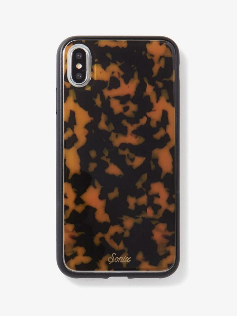 Women wearing a phone case rental from Sonix called Brown Tortoise, Iphone Xs Max