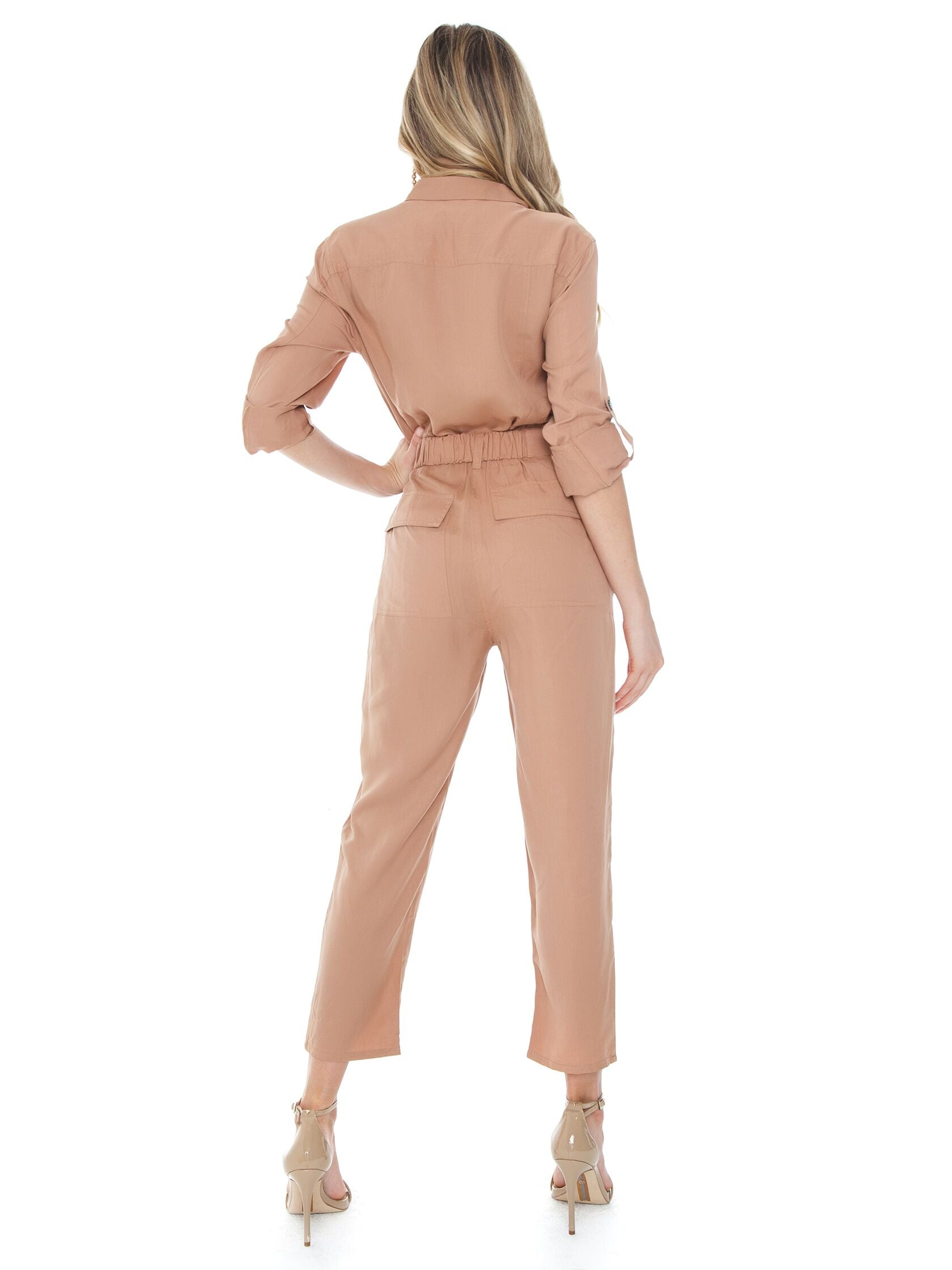 Women wearing a jumpsuit rental from BARDOT called Buckle Up Jumpsuit