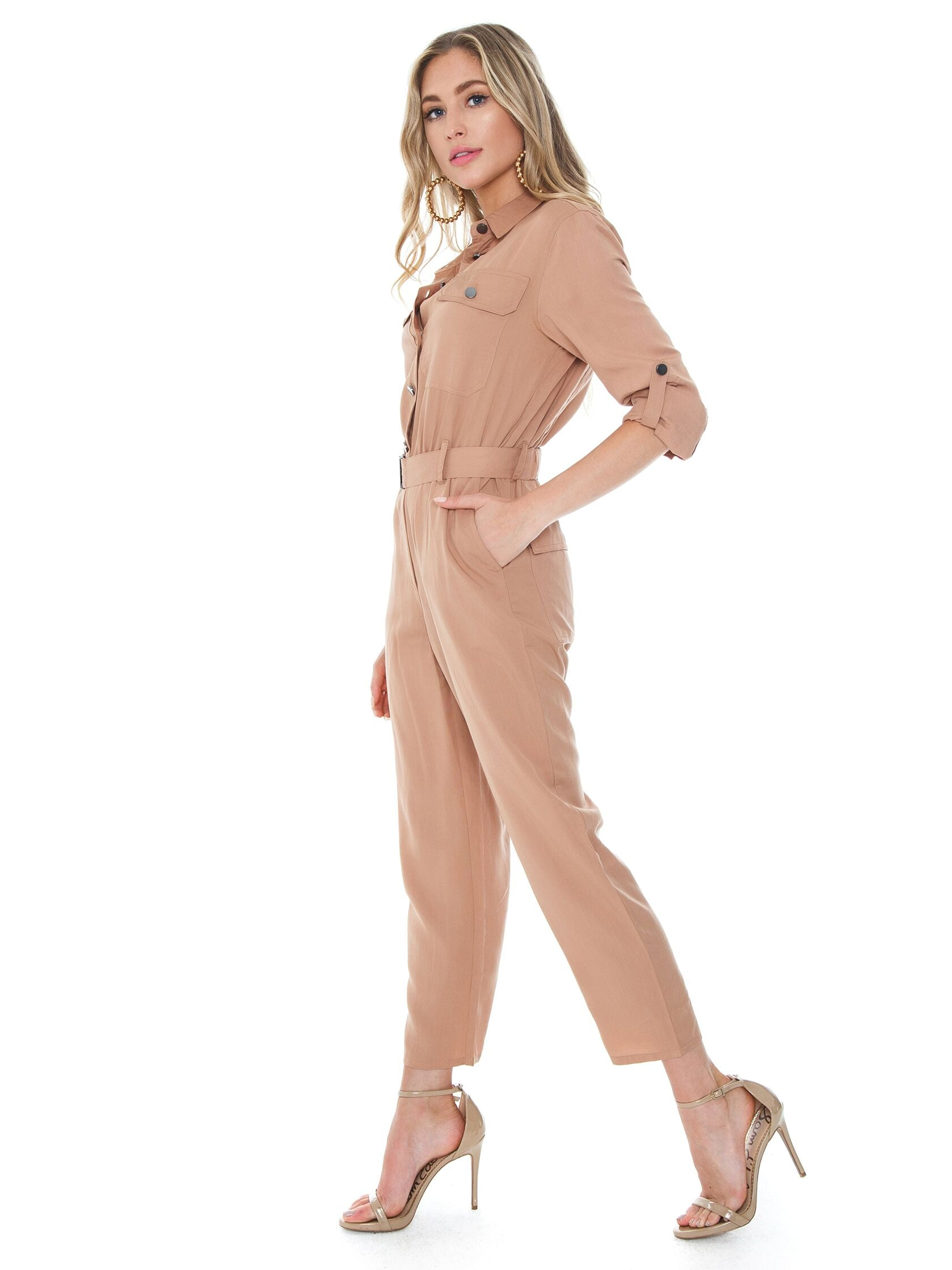Woman wearing a jumpsuit rental from BARDOT called Buckle Up Jumpsuit
