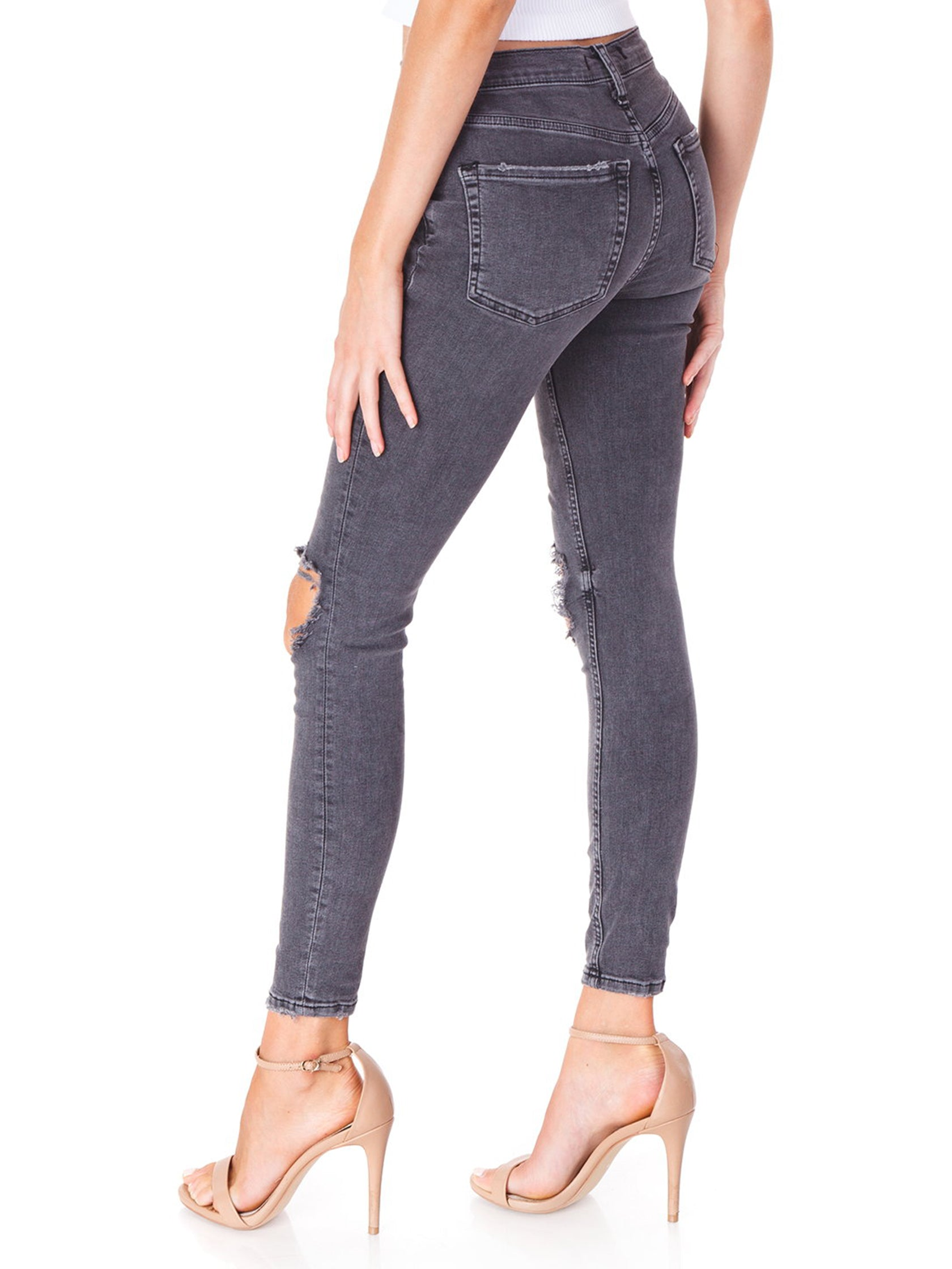 Women outfit in a denim rental from Free People called Busted Knee Skinny Jeans