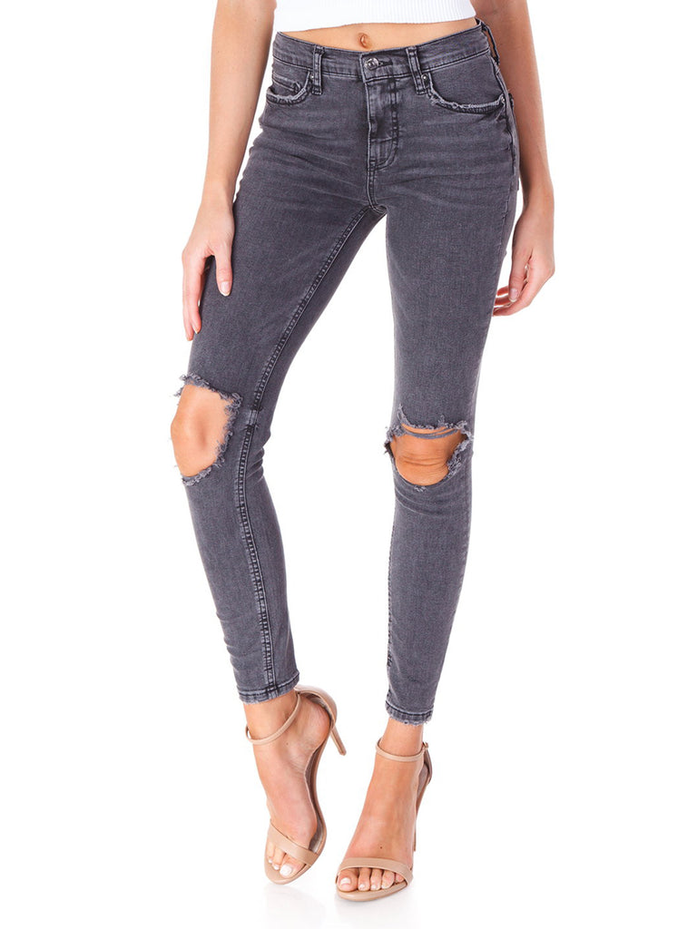Women wearing a denim rental from Free People called Busted Knee Skinny Jeans