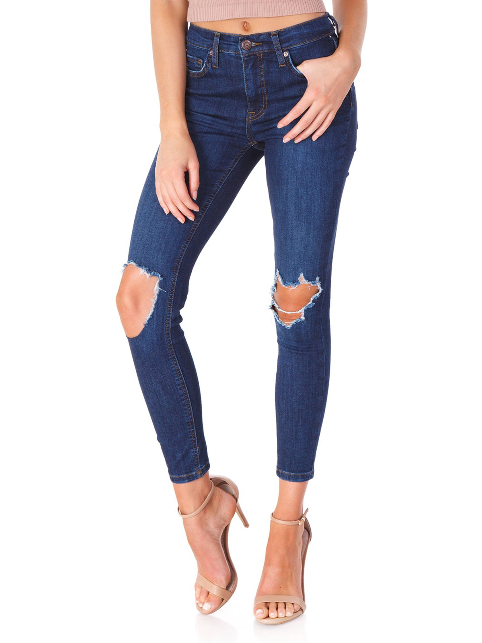 Woman wearing a denim rental from Free People called Busted Knee Skinny Jeans