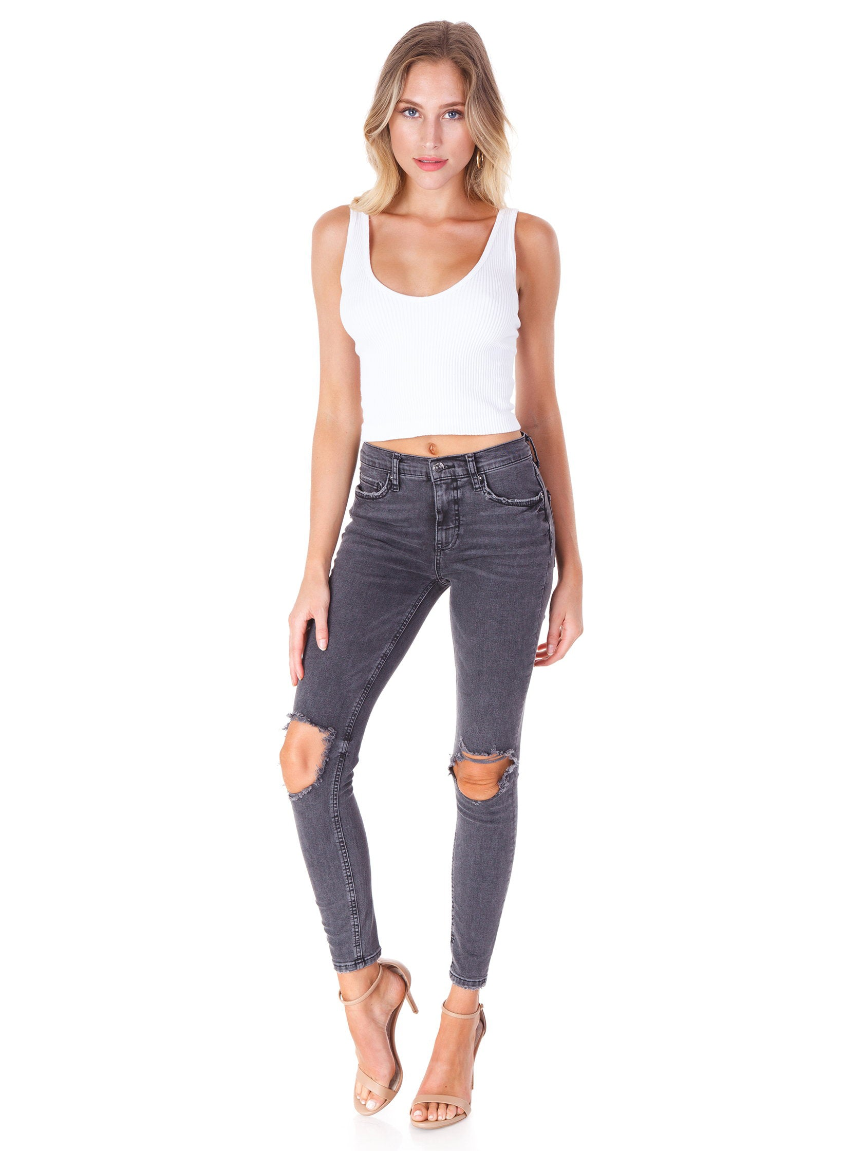 Girl wearing a denim rental from Free People called Busted Knee Skinny Jeans