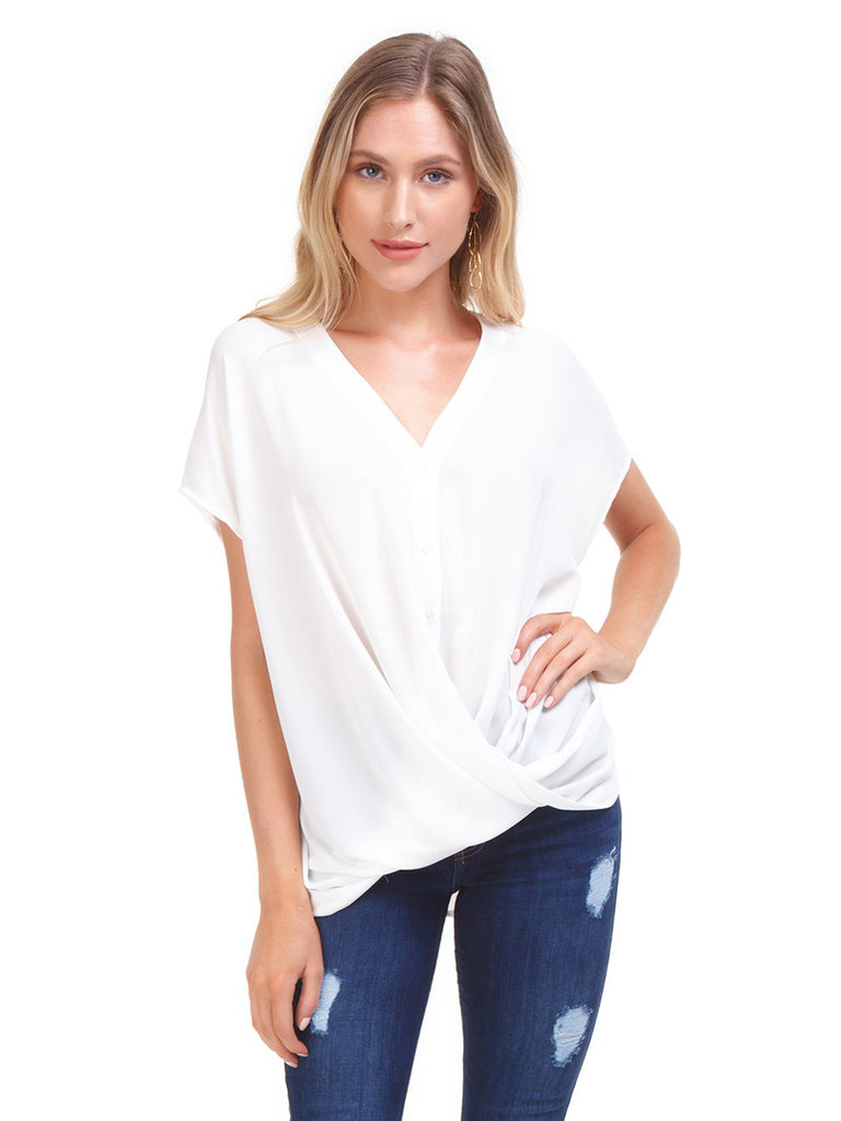 Woman wearing a top rental from Lush called V-neck Ruffle Sleeve Top