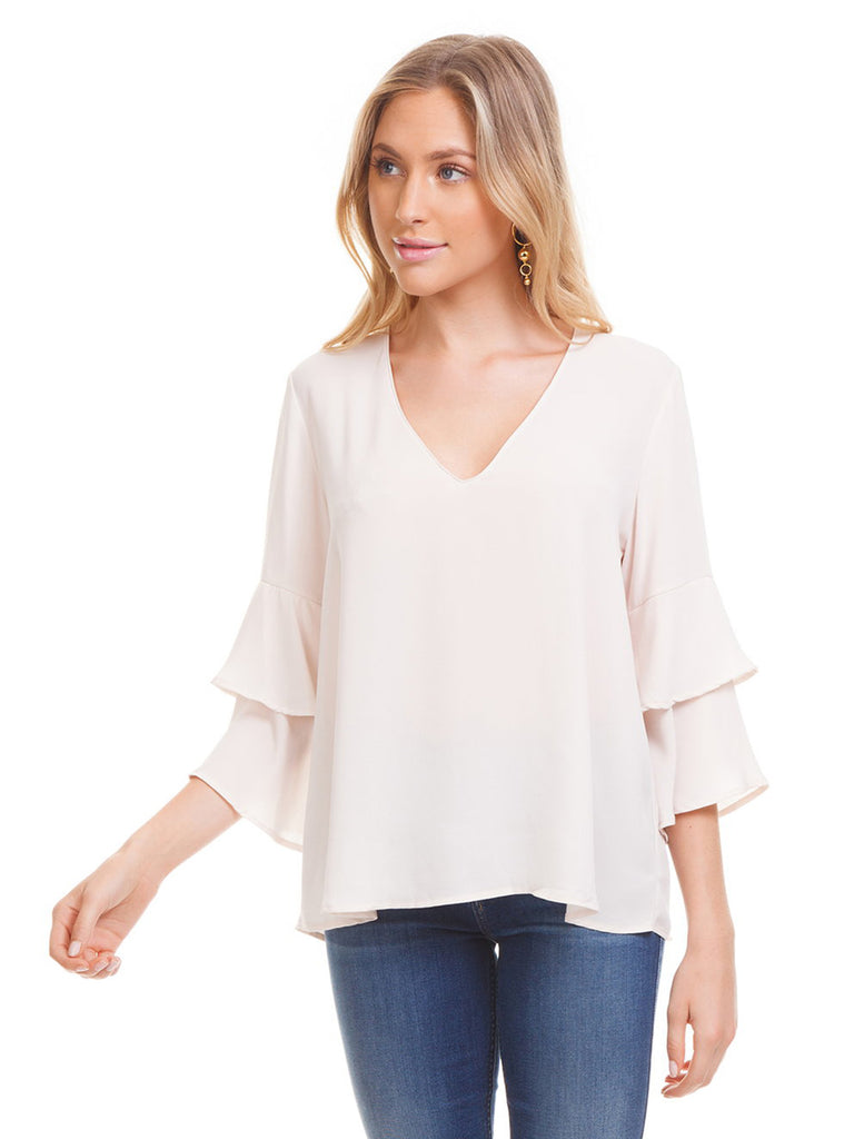 Women wearing a top rental from Lush called V-neck Ruffle Sleeve Top