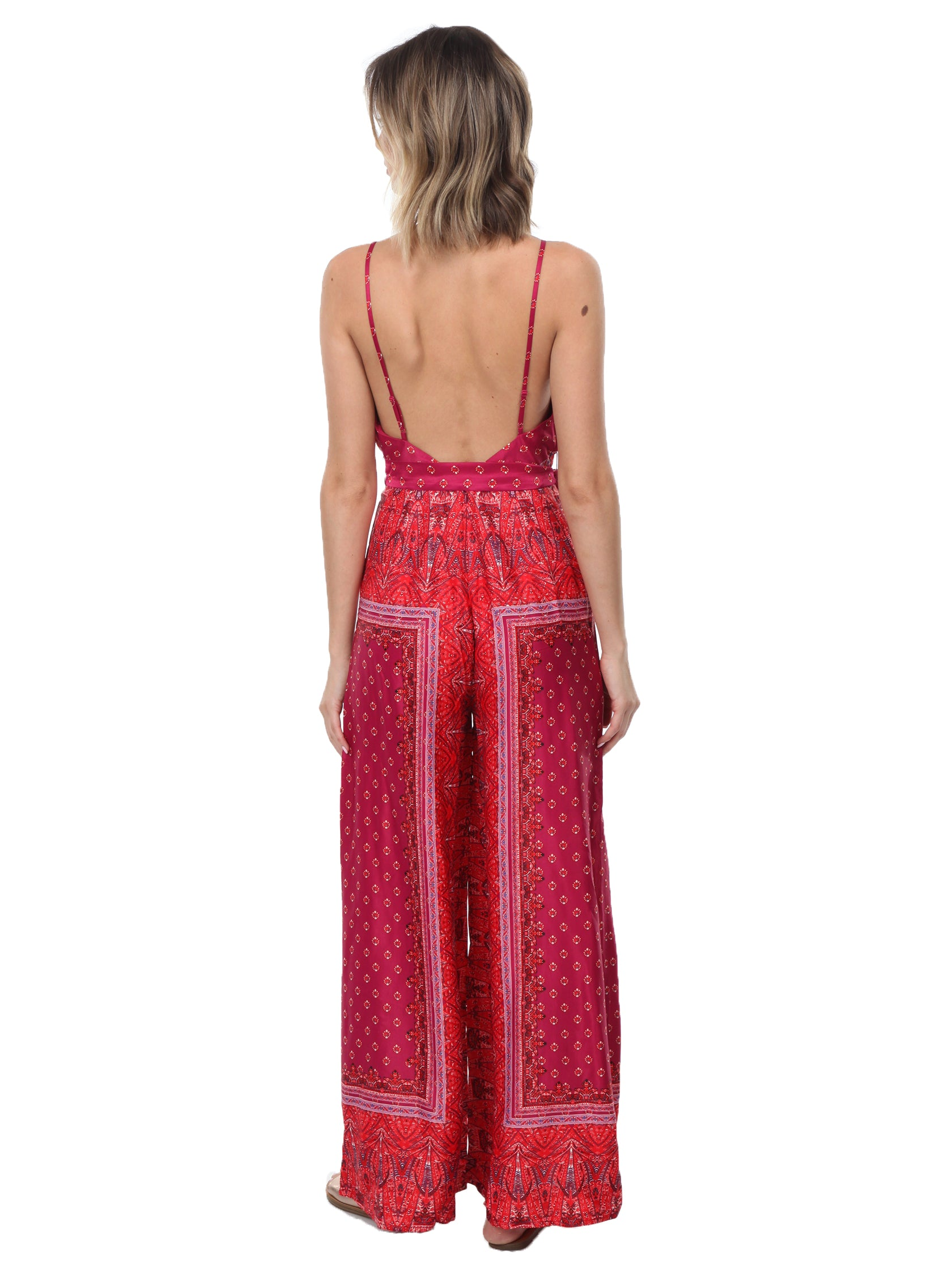 b7551f146fd3 Women wearing a jumpsuit rental from Free People called Cabbage Rose  Jumpsuit